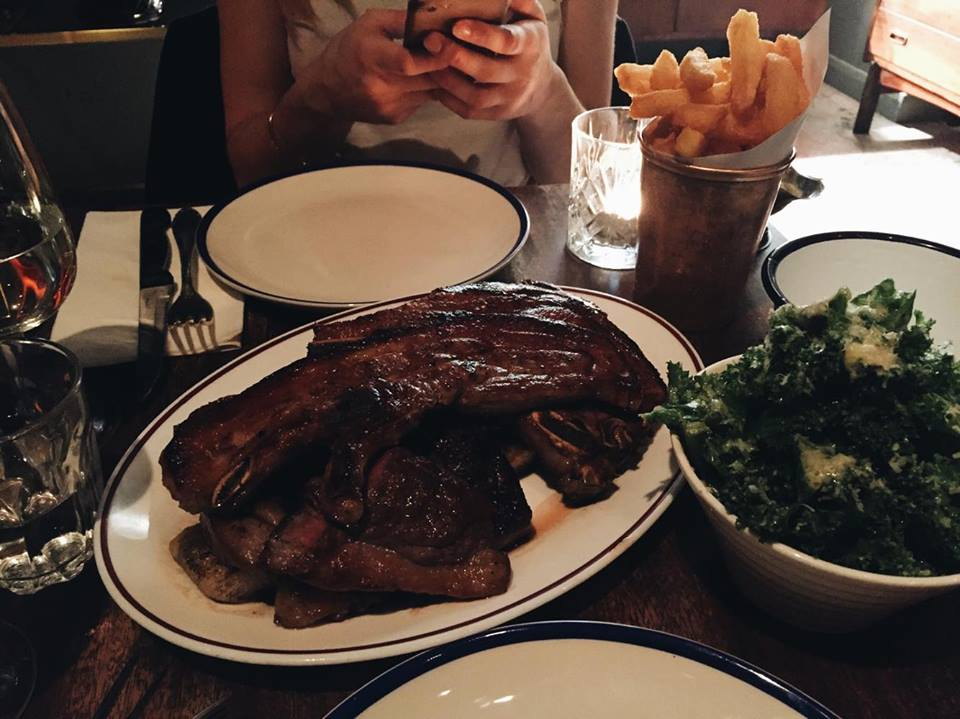 """""""All In"""" £20 per head   Parmesan kale, beef dripping chips, pork chop, lamb chop, and rare steak on top of a rosemary, meat-soaked flatbread."""
