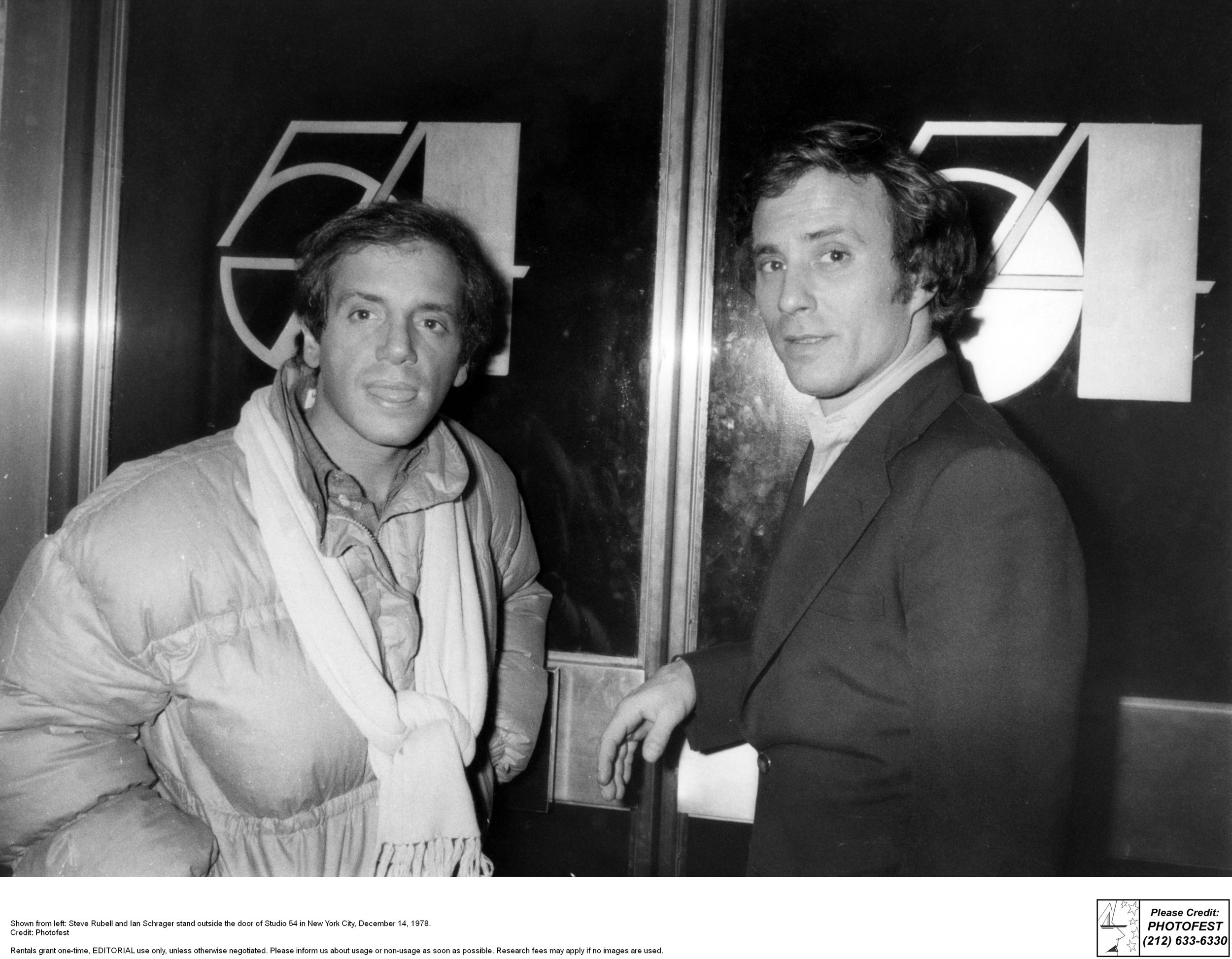 Steve Rubell and Ian Schrager stand outside Studio 54 doors. Photographer: Photofest