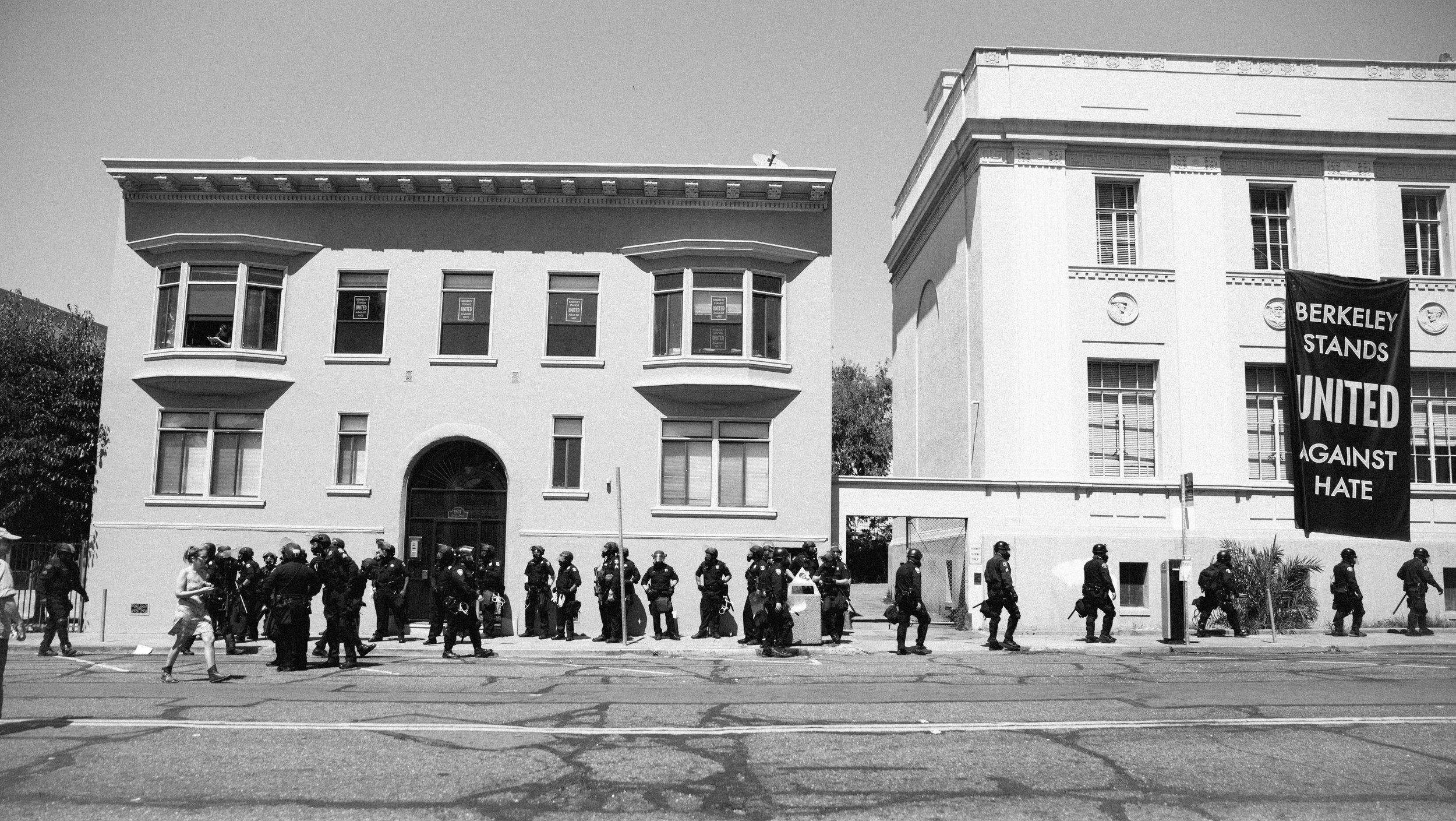 "Police Gather In Berkley under ""Berkeley Stands United Againt Hate"" Sign"