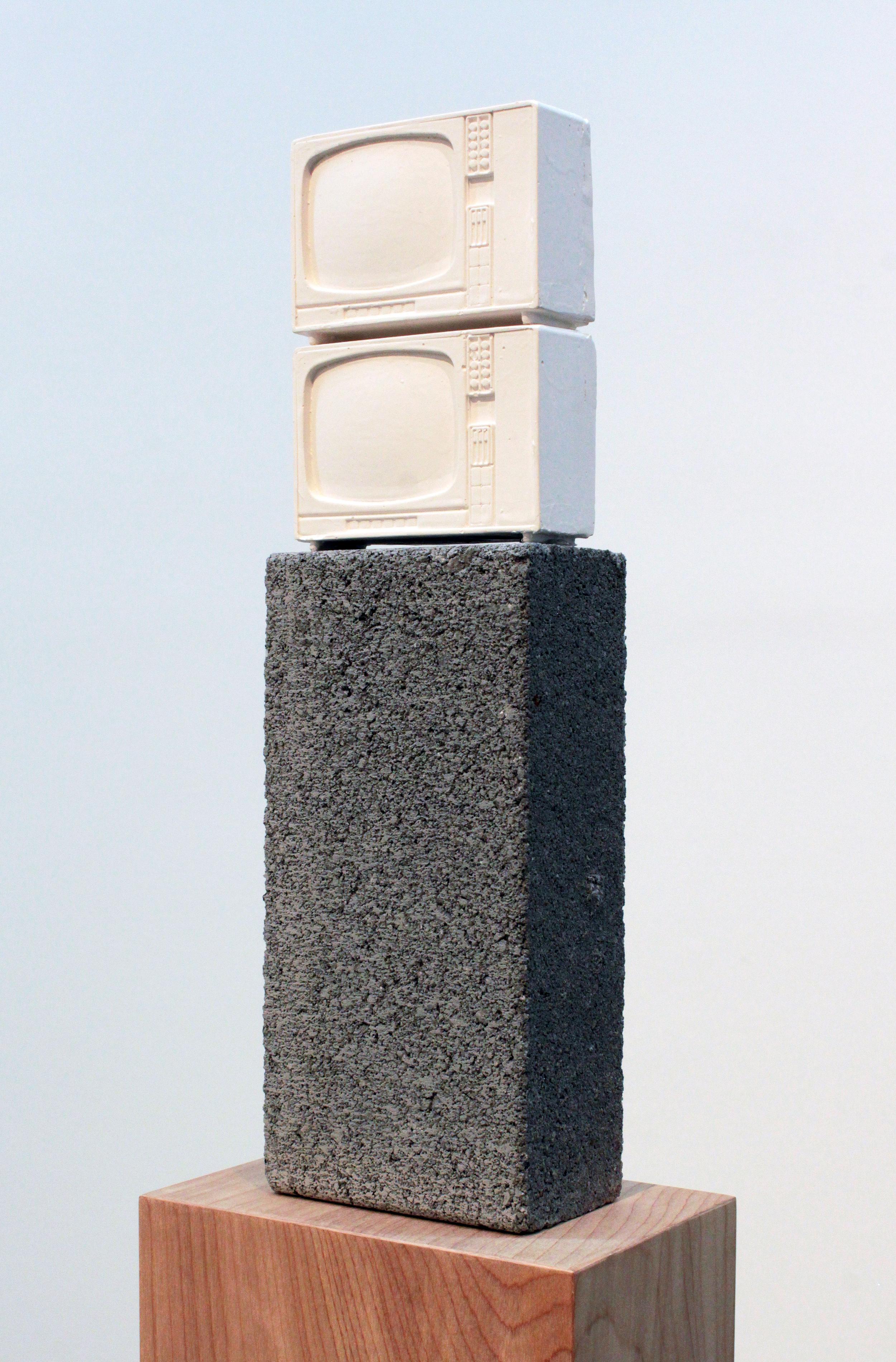 Esperanza Mayobre © 2010  ,   Monumento a la TV (y a Brancusi)  . Hydrocal, wood, concrete block. 50 x 7 x 5 in. Courtesy of the artist.