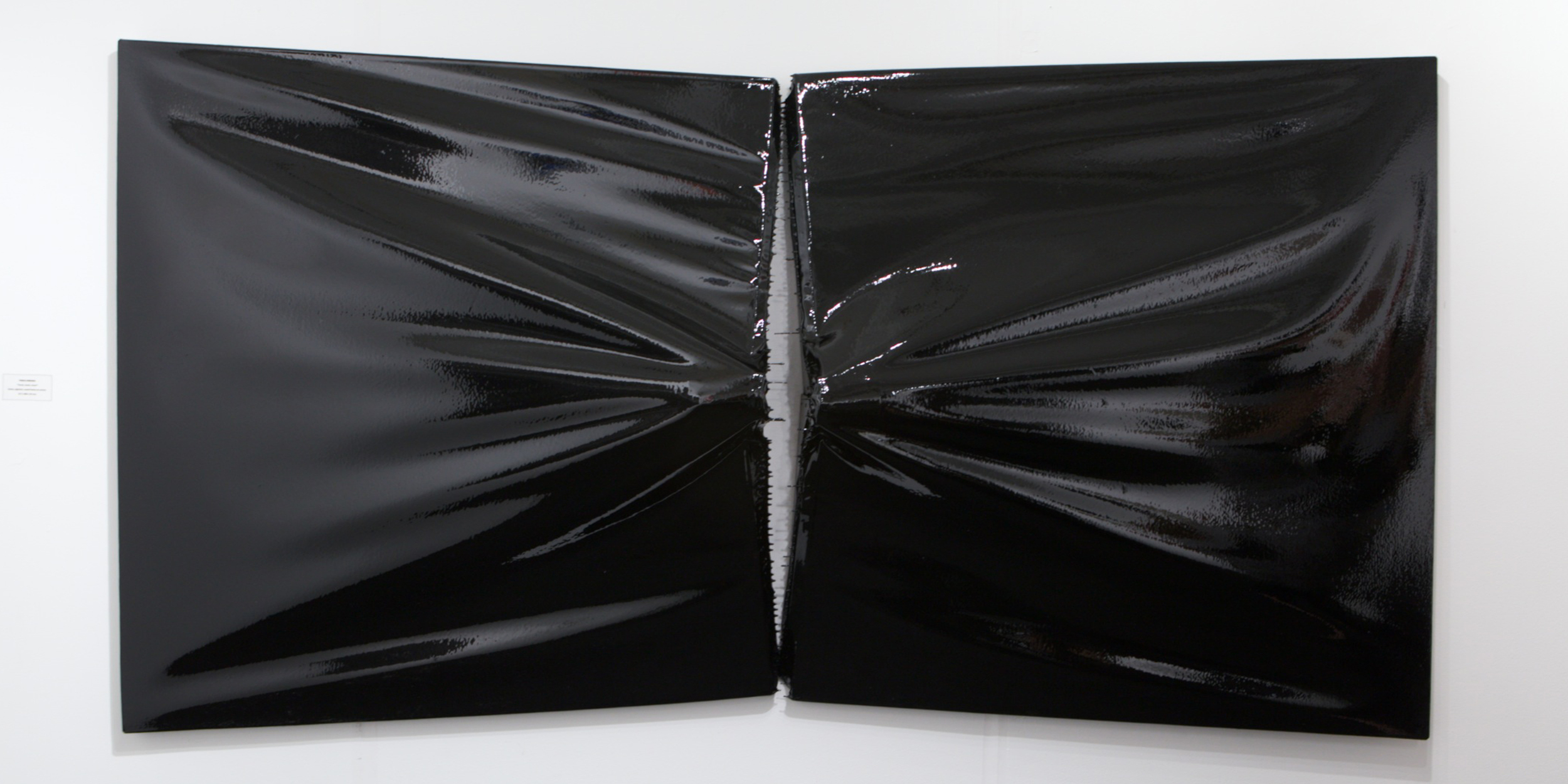 Pablo Jansana © 2014 ,  B1 & B2 . Installation view at Eleven Rivington, New York. Epoxy and pigment on canvas. 127 x 306 x 35 cm. Courtesy of the artist and Eleven Rivington.