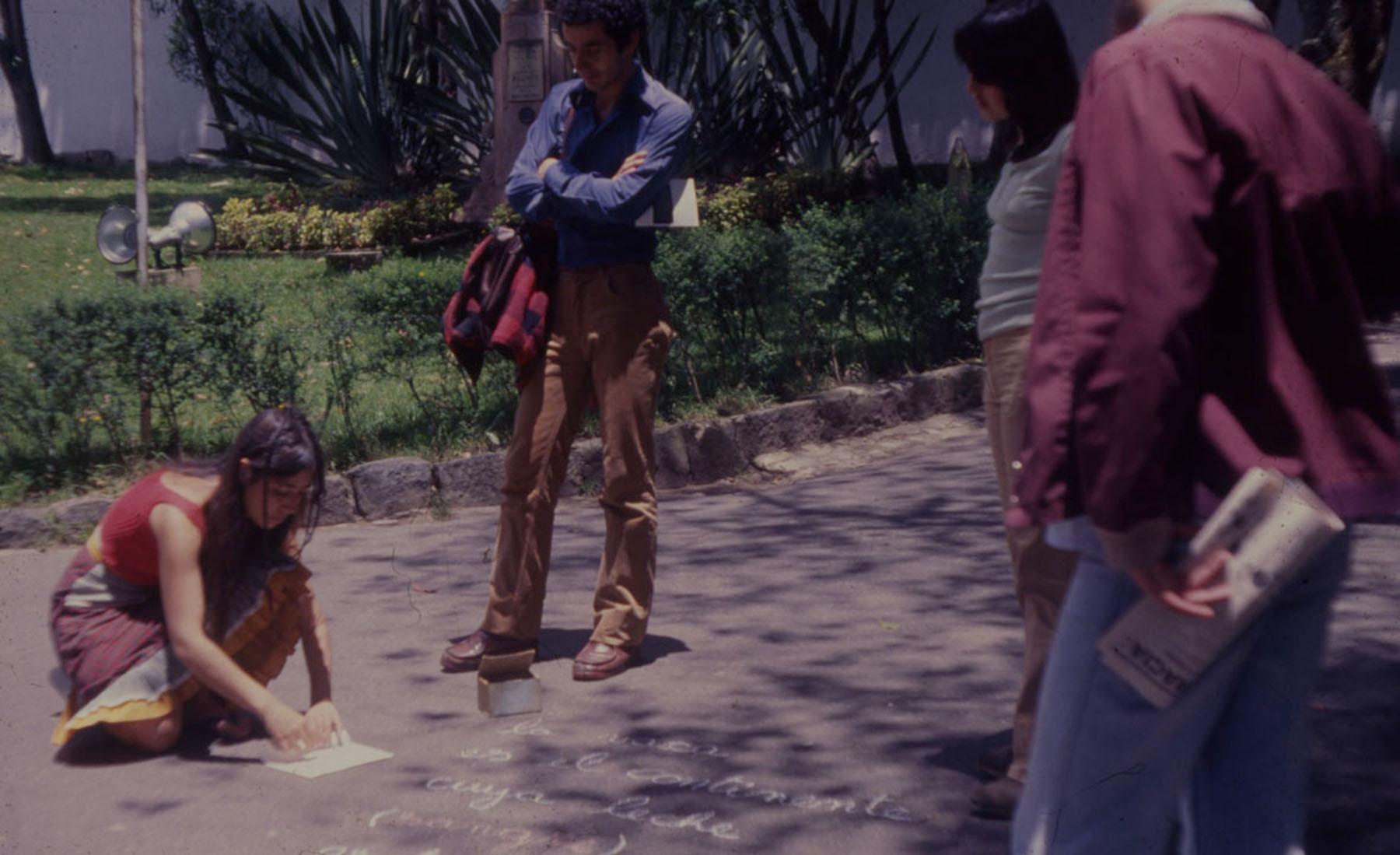 Cecilia Vicuña © 1979 ,  Para no morir de hambre en el arte  - Reina Sofia. Photography of the action in Bogota, Colombia. Courtesy of the artist.