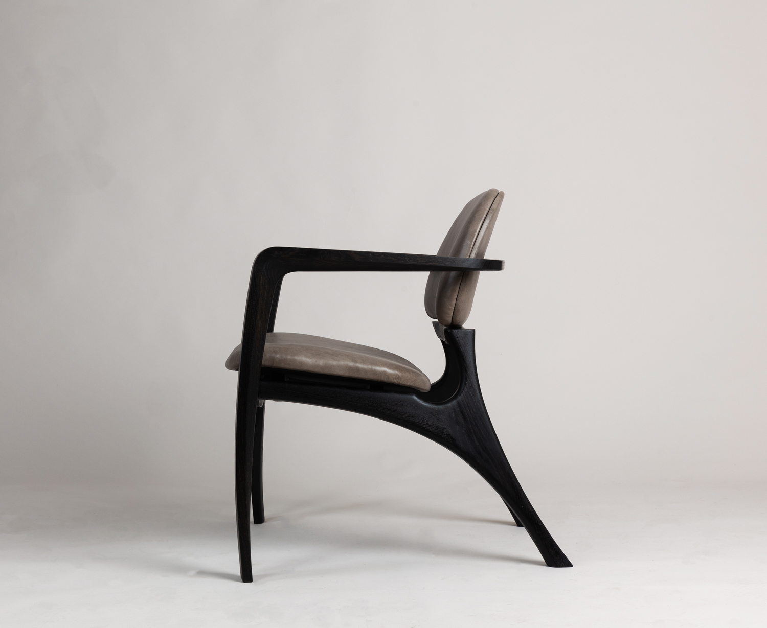 Amplex chair in ebonised Oak accented with grey leather seat and back rest