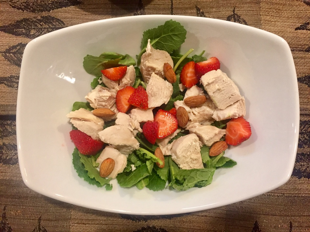 - 3 oz chicken breast (free range-humane- Costco)1/2 cup organic Strawberries (Trader Joes)7-8 whole Almonds (Trader Joes)2 cups of Traders Joes mixed organicGreens (kale and spinach)Olive oil (Tbs) and salt to taste