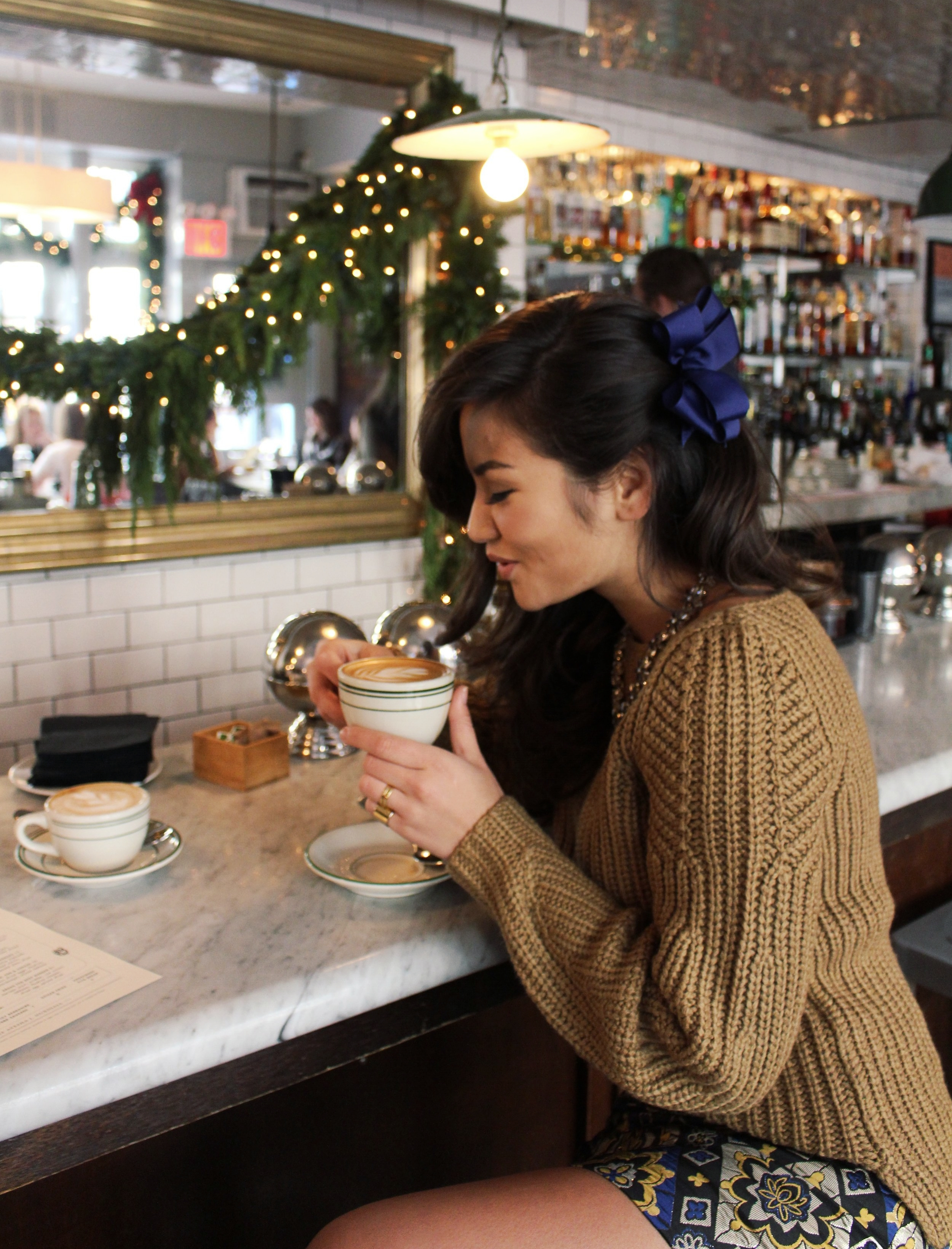 LOFT Mustard Christmas Sweater Caila Quinn drinking coffee