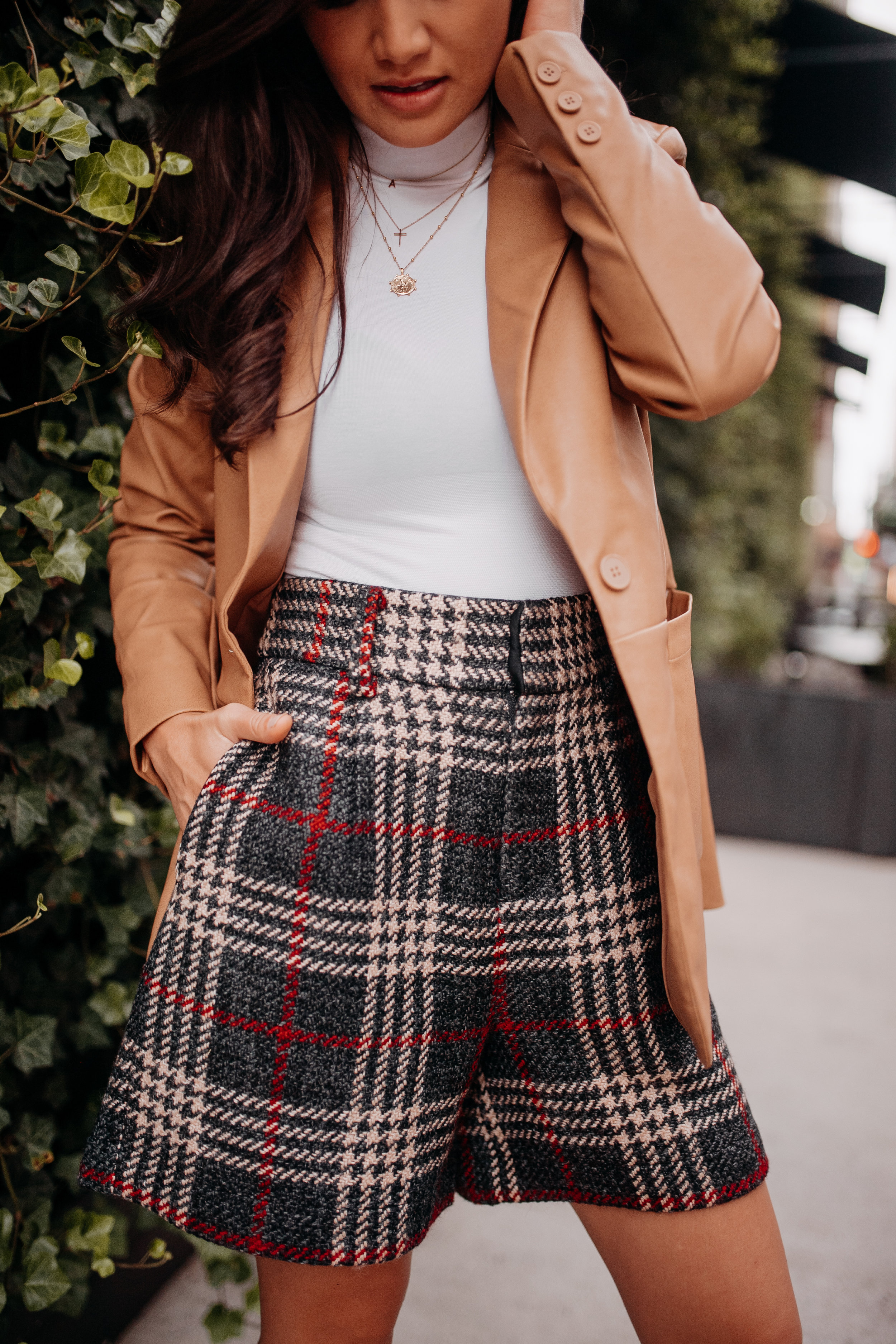 Caila Quinn The Bachelor Express Clothing Fall NYFW New York Fashion Week 2019 plaid shorts leather blazer white turtleneck outfit