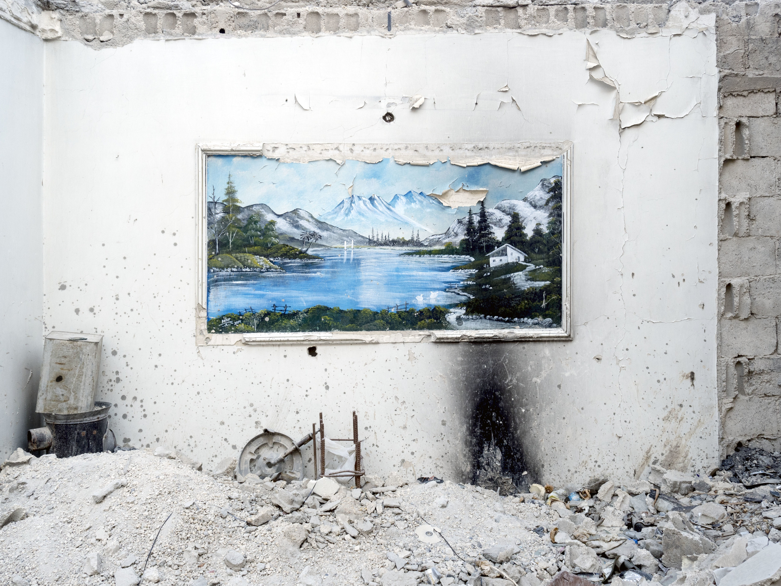 Image above: ©Lorenzo Meloni, SYRIA. Kobani / Kobane (Arabic: Ayn al Arab) . 09 August 2015. A painting inside a destroyed building / Courtesy of Magnum Photos