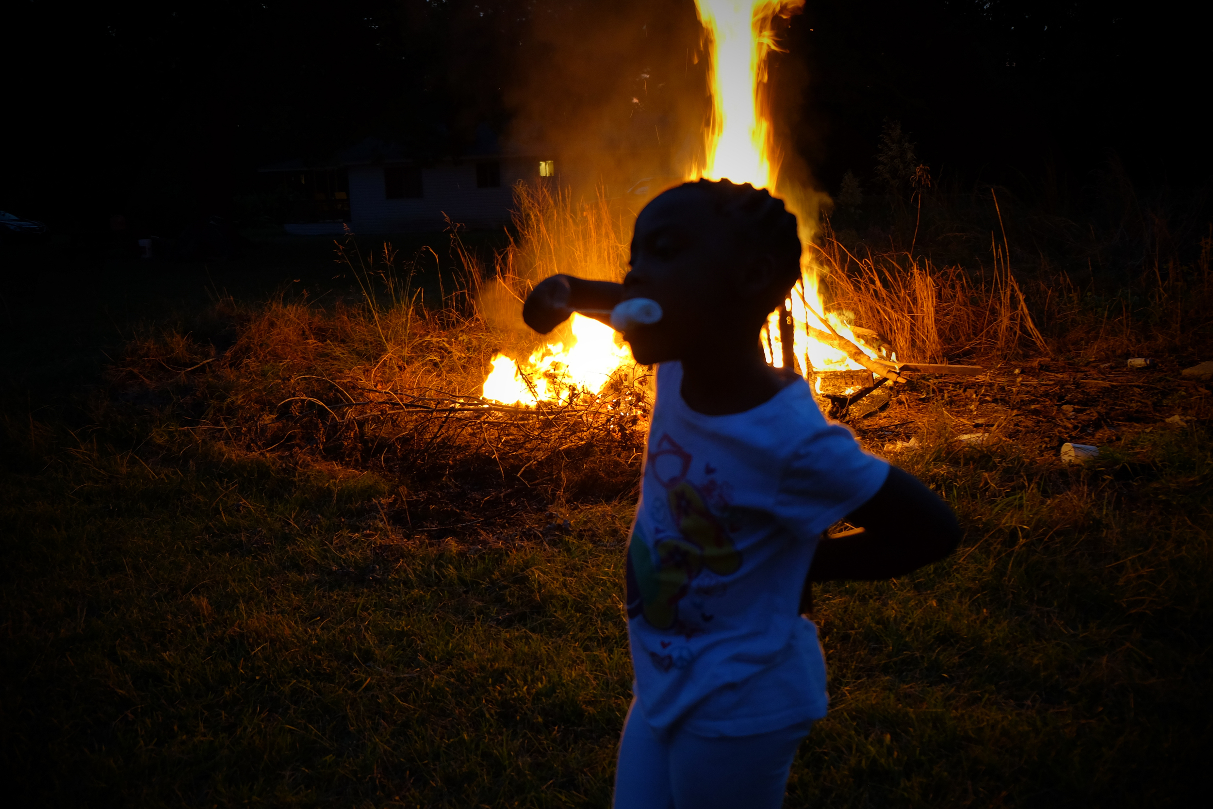 Cousin Miyah devouring marshmallows in front of a bonfire on the family property, Dalark, Arkansas.