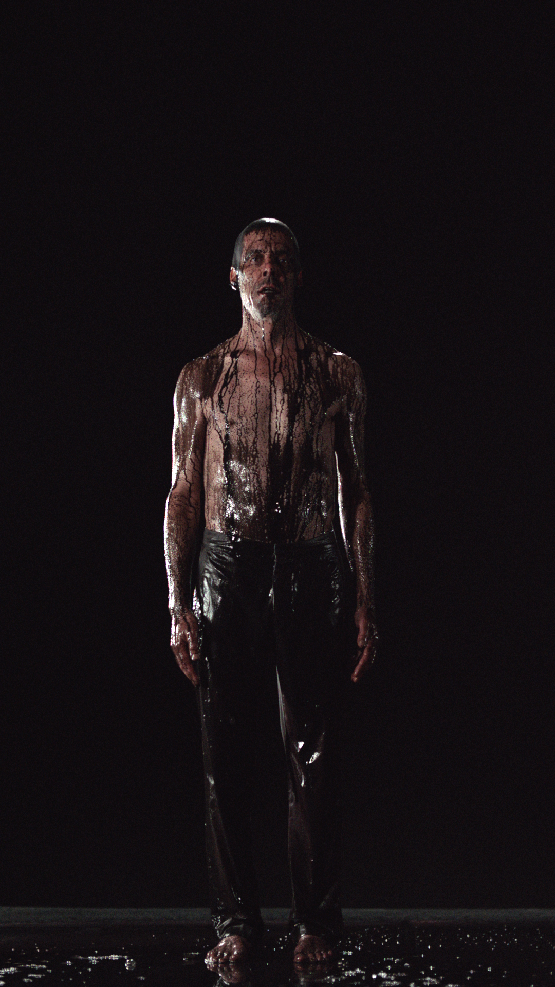 Image Above:©Bill Viola. Inverted Birth, 2014, Video/sound installation, Color high-definition video projection on screen mounted vertically and anchored to floor in dark room; stereo sound with subwoofer (2.1), Projected image size: 16 ft 5 in. x 9 ft 3 in. (5 x 2.81 m), 8:22 minutes, Executive producer: Kira Perov, Performer: Norman Scott.