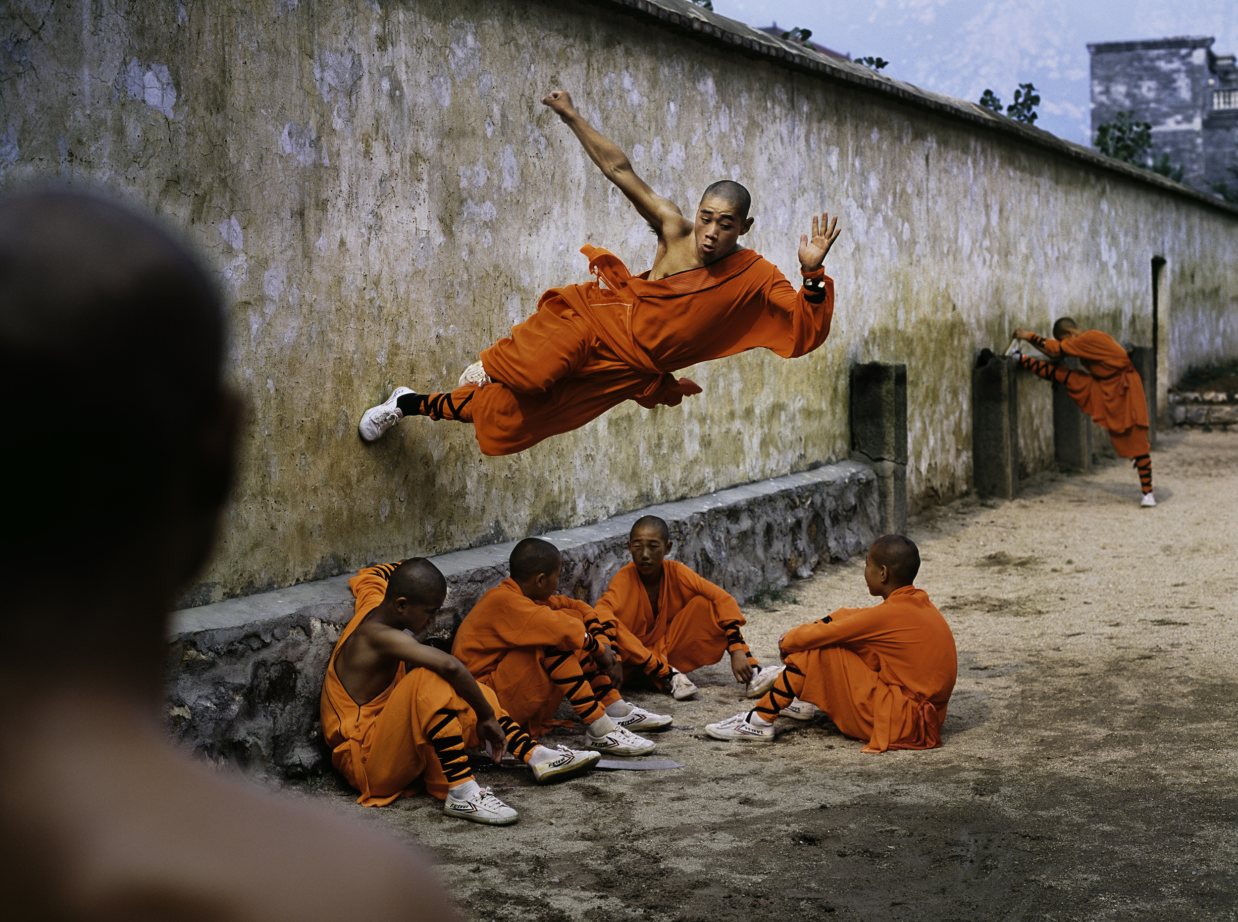 Image above: ©Steve McCurryA young monk runs along the wall over his peers at the Shaolin Monastery in Henan Province, China, 2004, ultrachrome print
