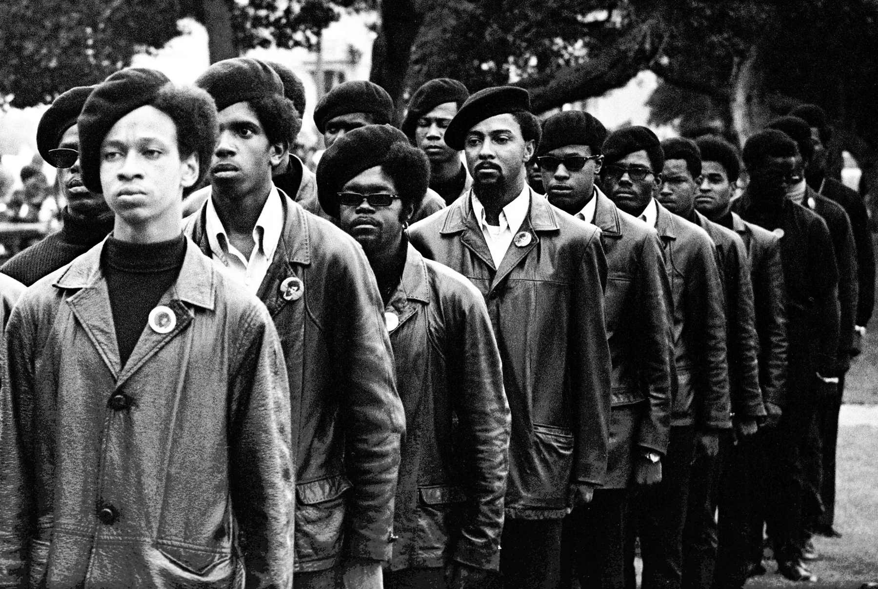 Image Above: Panthers line up at a Free Huey rally in DeFremery Park, Oakland, July 28, 1968. The light-skinned man is Gregory Harrison. His brother, Oleander, was in the group that went to Sacramento.All images: Stephen Shames, Courtesy of Steven Kasher Gallery