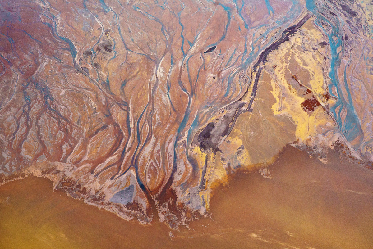 Oh Minas Gerais - New number 9 Aerial Photograph, Feb 2016. Wet season in Brazil, 3 months after the environmental accident. Photograph taken close to Bento Rodrigues, Minas Gerais over the course of the dead Rio Doce (Doce River). Mud, tailings from iron ore and water.