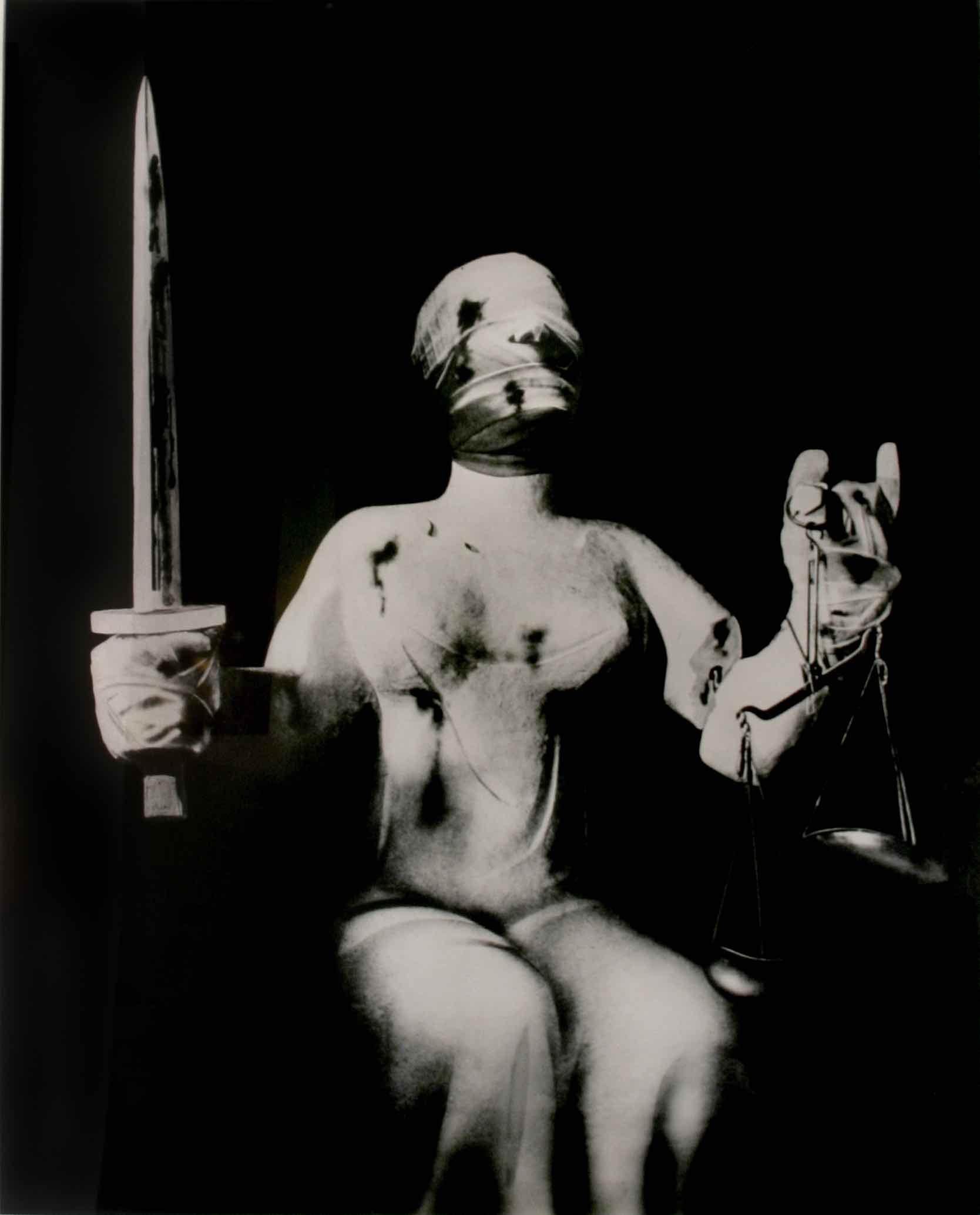 """John Heartfield (1891-1968) Der Henker und Die Gerechtigkeit (""""The Executioner and Justine""""), c. 1933 gelatin silver print 37 x 29 1⁄2 inches courtesy Ubu Gallery, New York."""