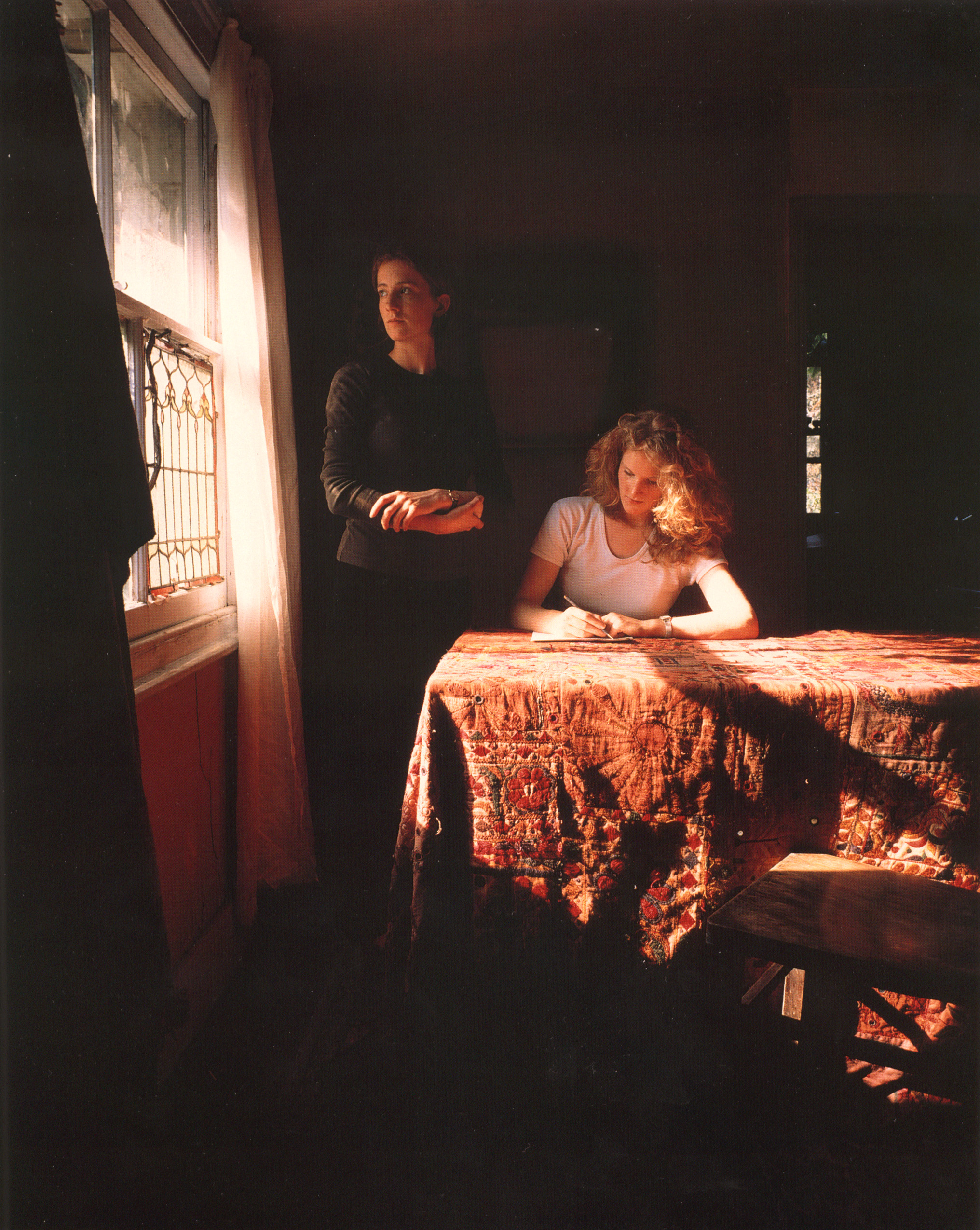 Girl Writing an Affidavit, 1997. Cibachrome print. © Tom Hunter, courtesy of the artist, and Yancey Richardson Gallery, New York