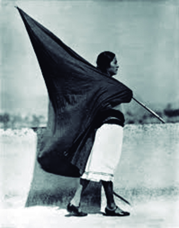 Woman with Flag, Photograph by: Tina Modotti