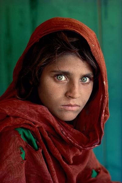 Steve McCurry (American, b. 1950)   Afghan Girl (Peshawar, Pakistan) , 1984. Courtesy of the artist and Cavalier Galleries New York