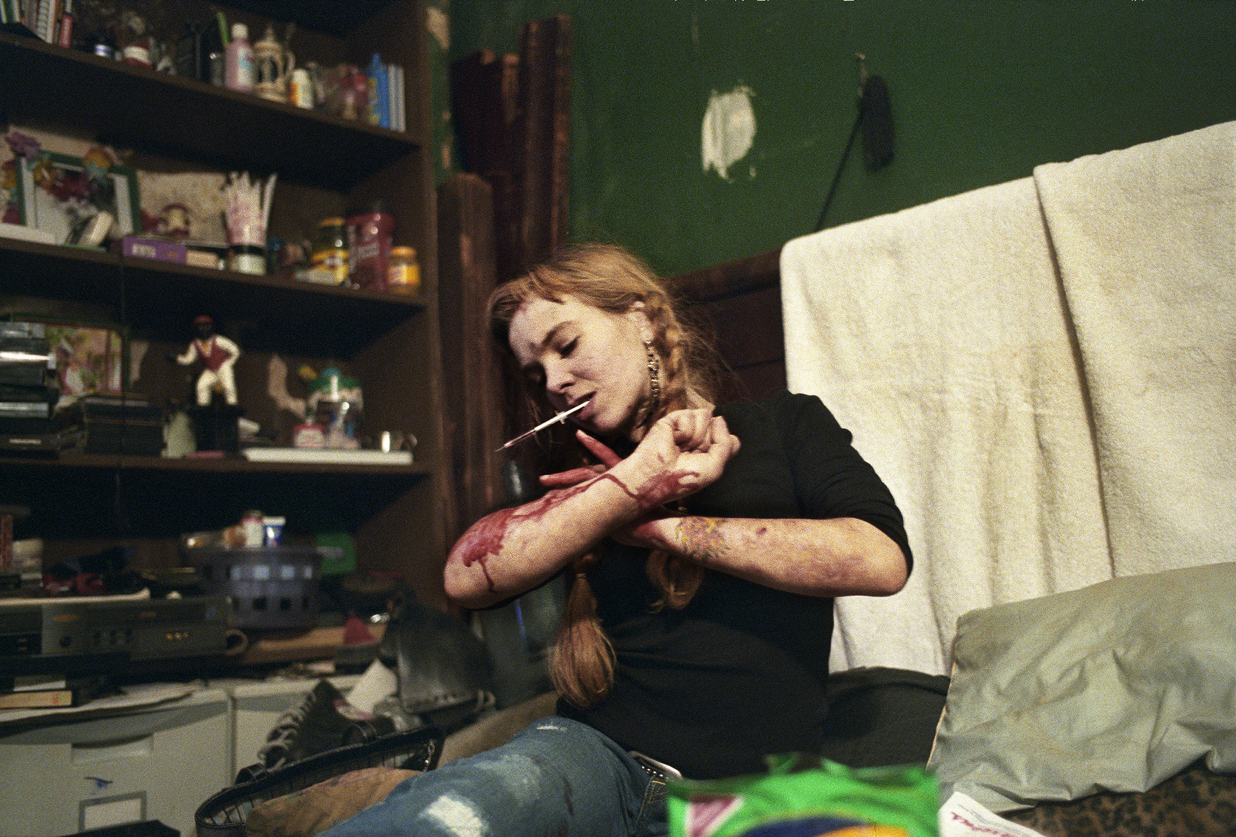 Natasha, who slept in the secret space behind a movable bookcase, bloodies her arms as she struggles for 45 minutes to find a vein in New York, N.Y. on March 14, 2005.