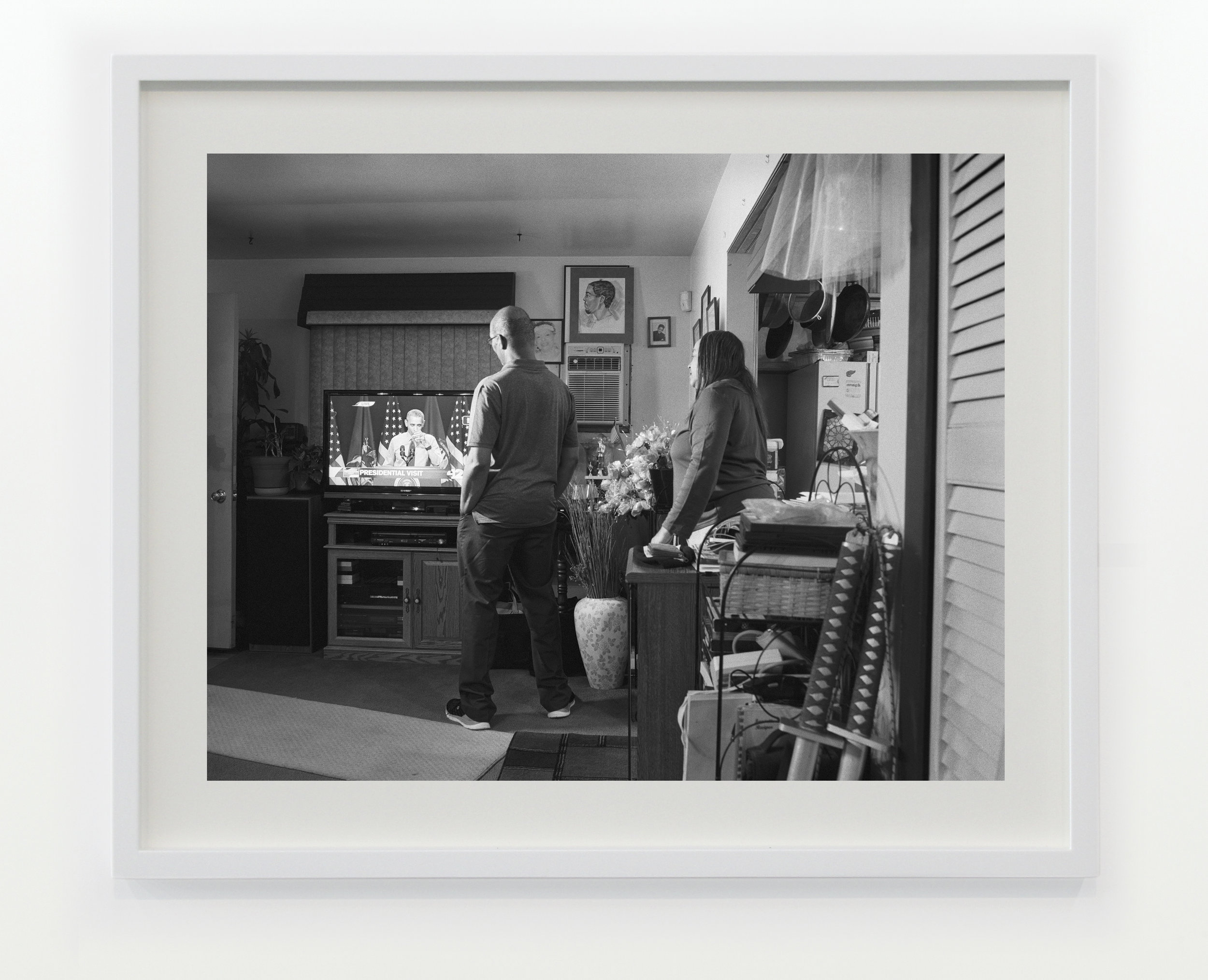 Shea's Aunt Denise and Uncle Rodney in their home on Foster Street watching President Obama take a sip of Flint water © 2016/2017