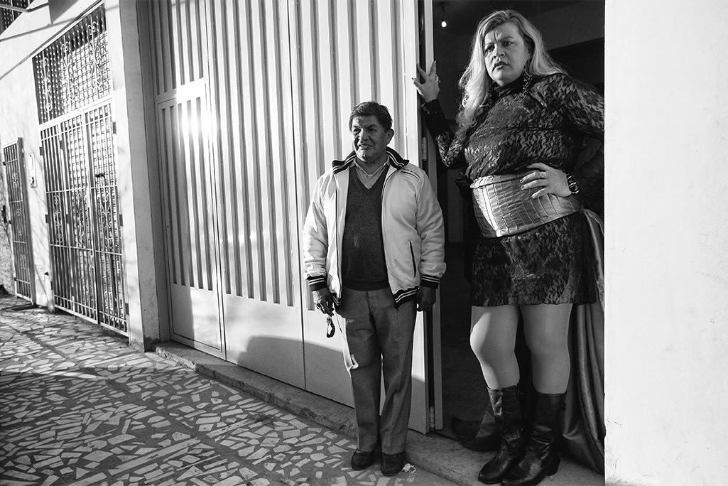 Serena stands at the entrance to the ballroom with her friend Miguel Angel, waiting for the guests to arrive at her birthday party. Copyright © 2018 by Kike Arnal. These images originally appeared in Revealing Selves: Transgender Portraits from Argentina, published by The New Press. Reprinted here with permission.