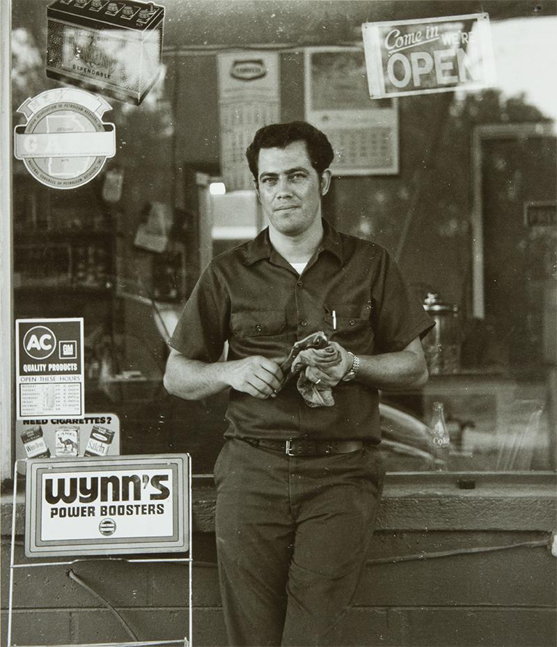 © Raymond Smith (American, born 1942),Garage Attendant, Colquitt, Georgia, 1974, gelatin silver print, Lent by the artist