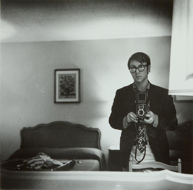 © Raymond Smith (American, born 1942), Self-Portrait, Motel Room, Williamsburg, Virginia, 1974, gelatin silver print, Lent by the artist