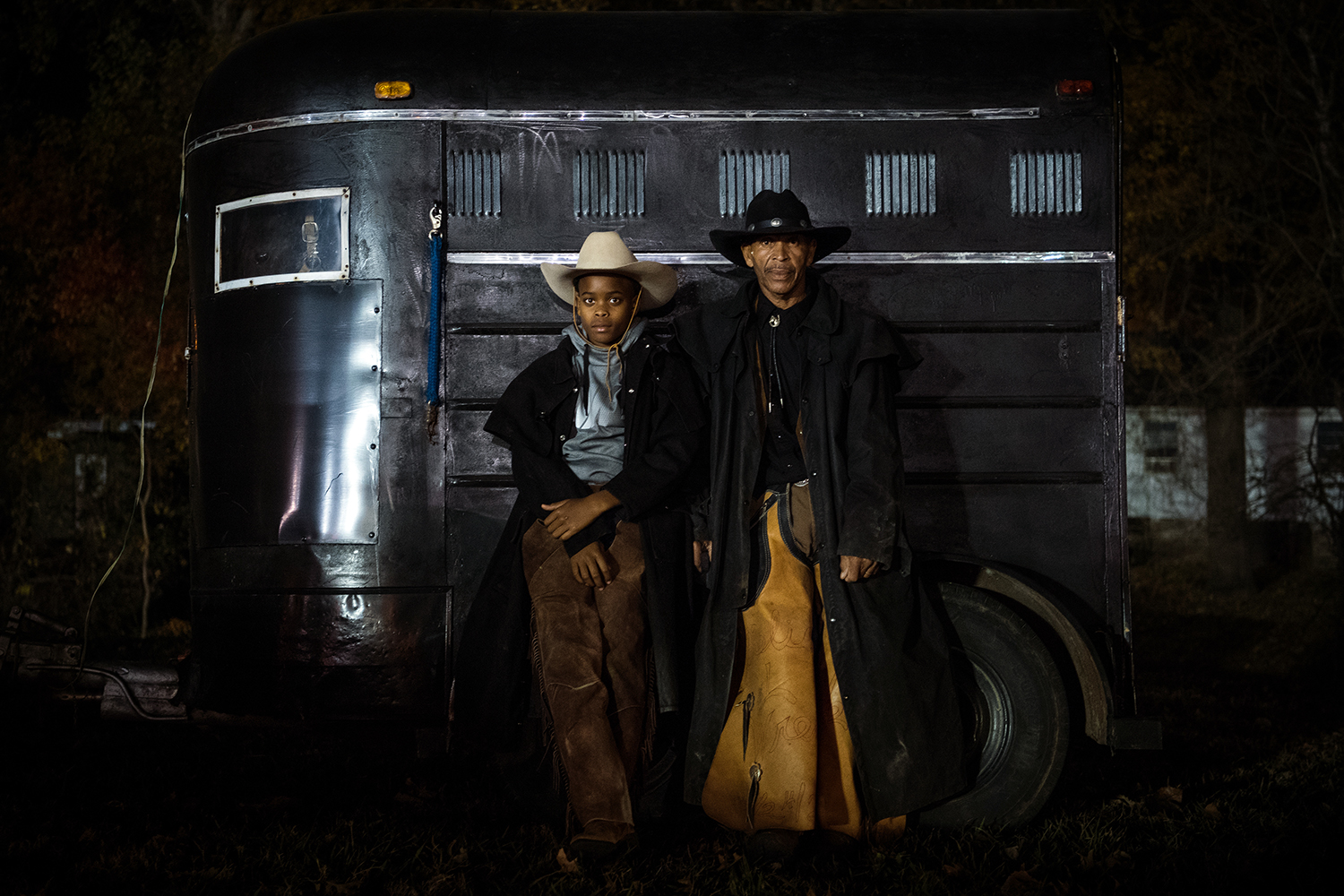 Grandson Javaris and grandfather Rogers pose for a portrait after riding their horses in the Christmas parade in Cleveland, Mississippi. Photo by Rory Doyle.
