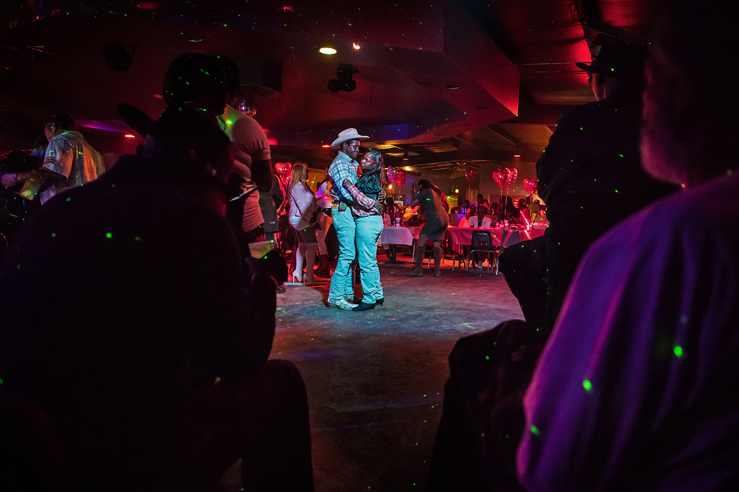 """Joe """"Dancing Cowboy"""" Wrenn and his wife Barbara take the floor at a Valentine's Day dance at Club Black Castle in Ruleville, Mississippi. Photo by Rory Doyle."""