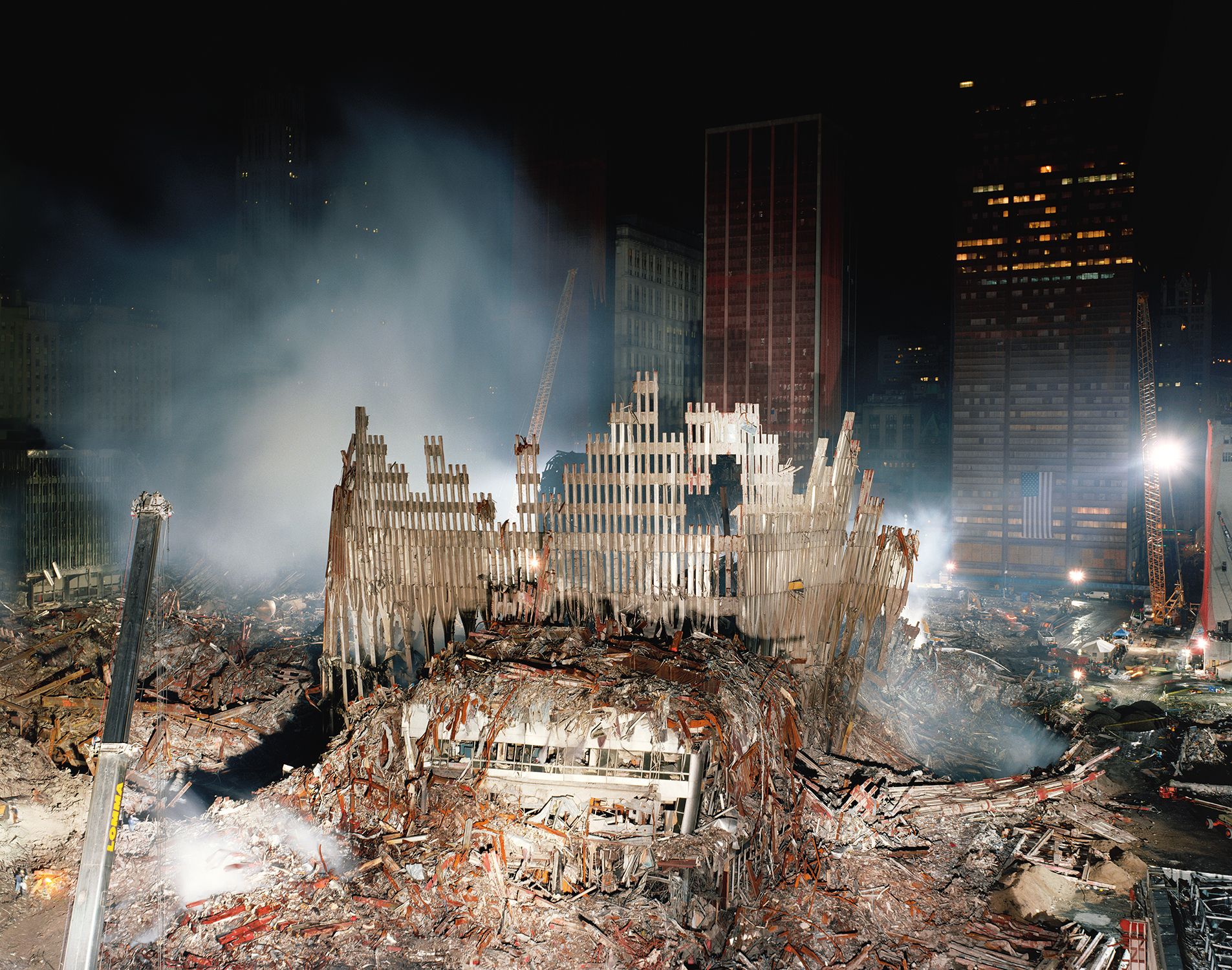 Courtesy and Copyright of Joel Meyerowitz   The base of the North Tower, looking east toward the Woolworth Building, New York City, 2001