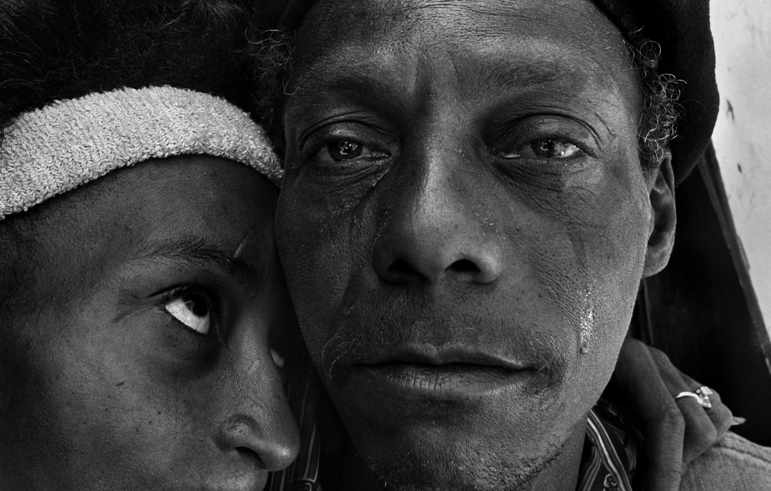 Back from prison, Shantytown, New York  , 1986. Gelatin silver print.  Collection of Eugene Richards. © Eugene Richards