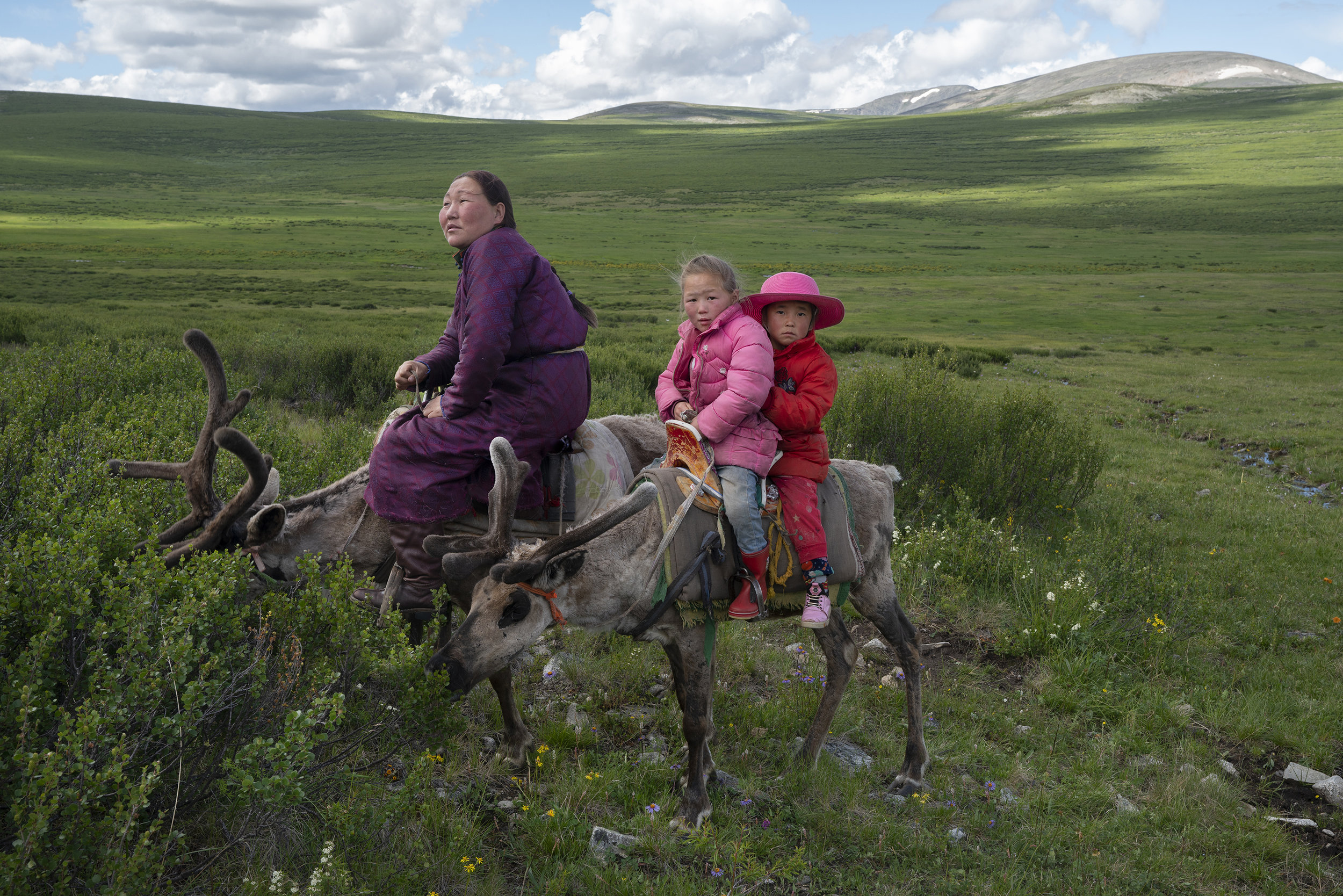 We came accross this little convoy in the middle of nowhere. It turns out they were trekking 4 hours to another camp. It was the first time I saw the Tsaaten riding the reindeer. It took my breath away, but eventually became the most natural thing in the world. © Meghan Boody