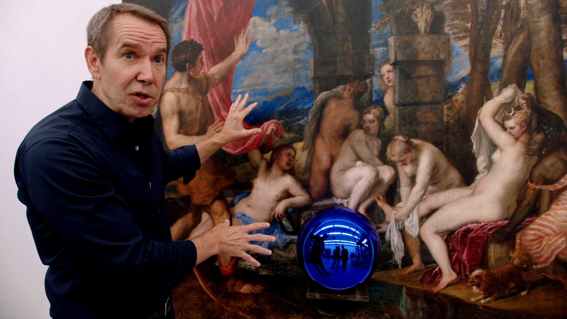 """Artist Jeff Koons in front of one of his """"Gazing Ball"""" paintings in  The Price of Everything , directed by Nathaniel Kahn. Courtesy of HBO Documentary Film."""