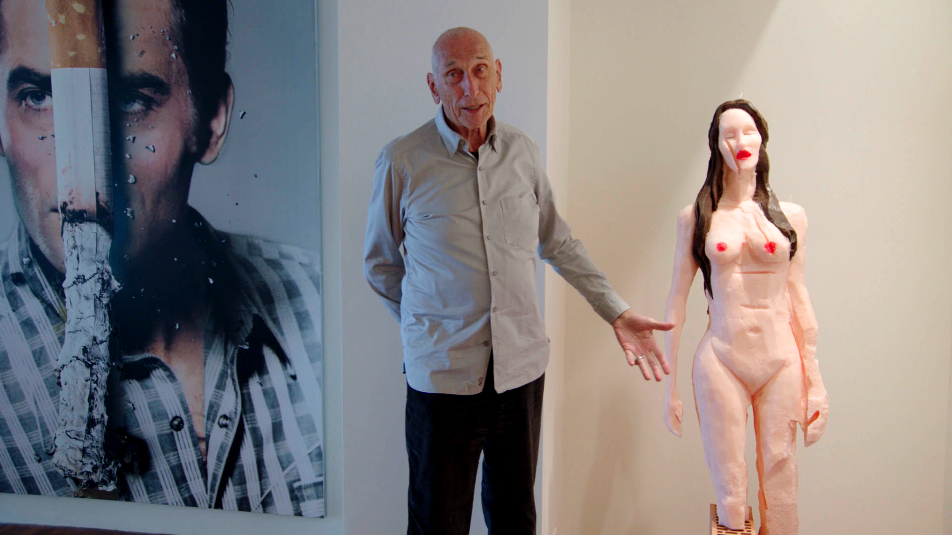 """Art collector Stefan Edlis in front of (l. to r.) artist Urs Fischer's """"Dried"""" collage and """"Untitled (Candle)"""" sculpture as part of Edlis' collection in  The Price of Everything , directed by Nathaniel Kahn. Courtesy of HBO Documentary Films."""