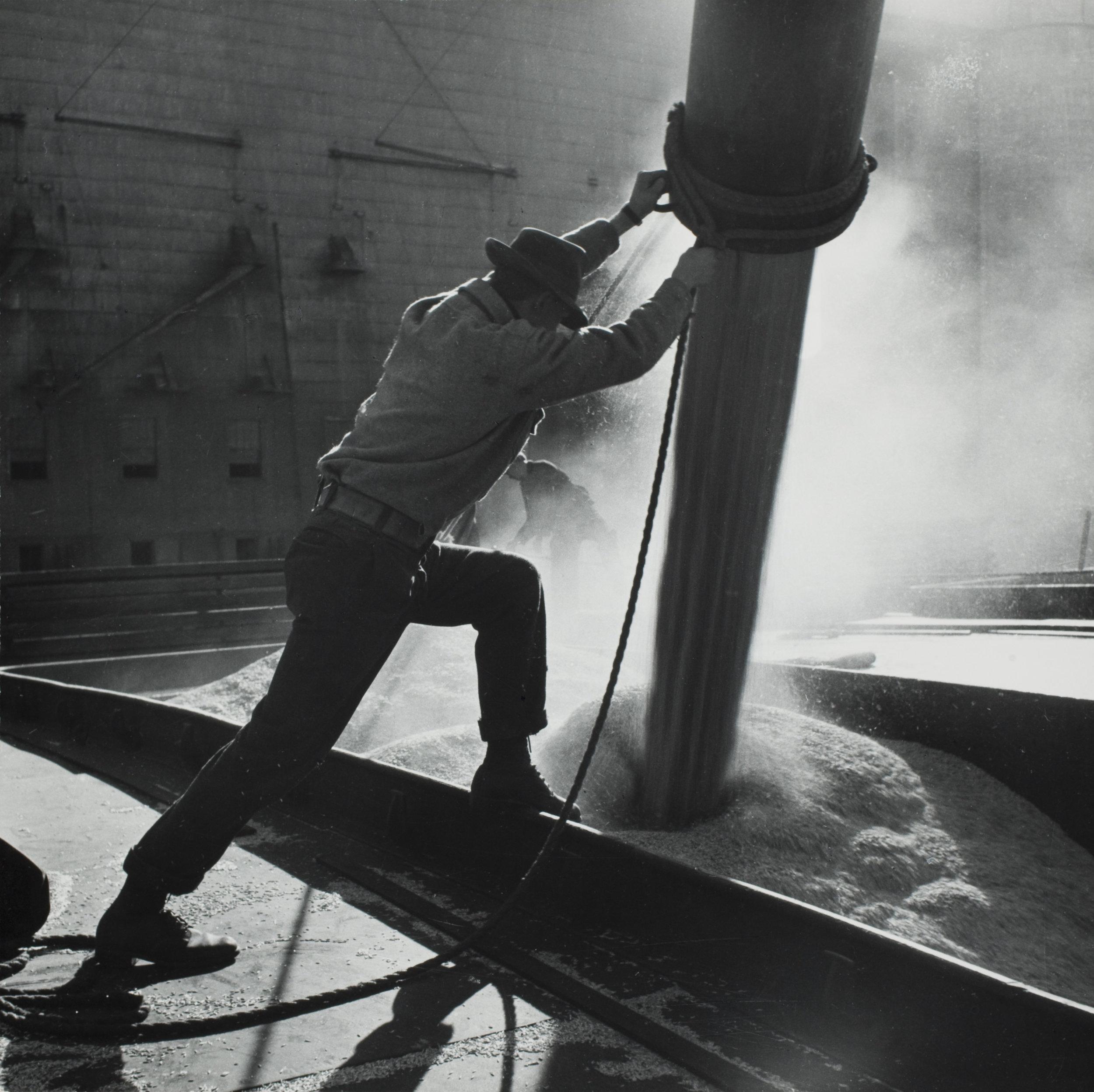 Grain Boat Taking on a Load of Wheat. 1945 © Gordon Parks