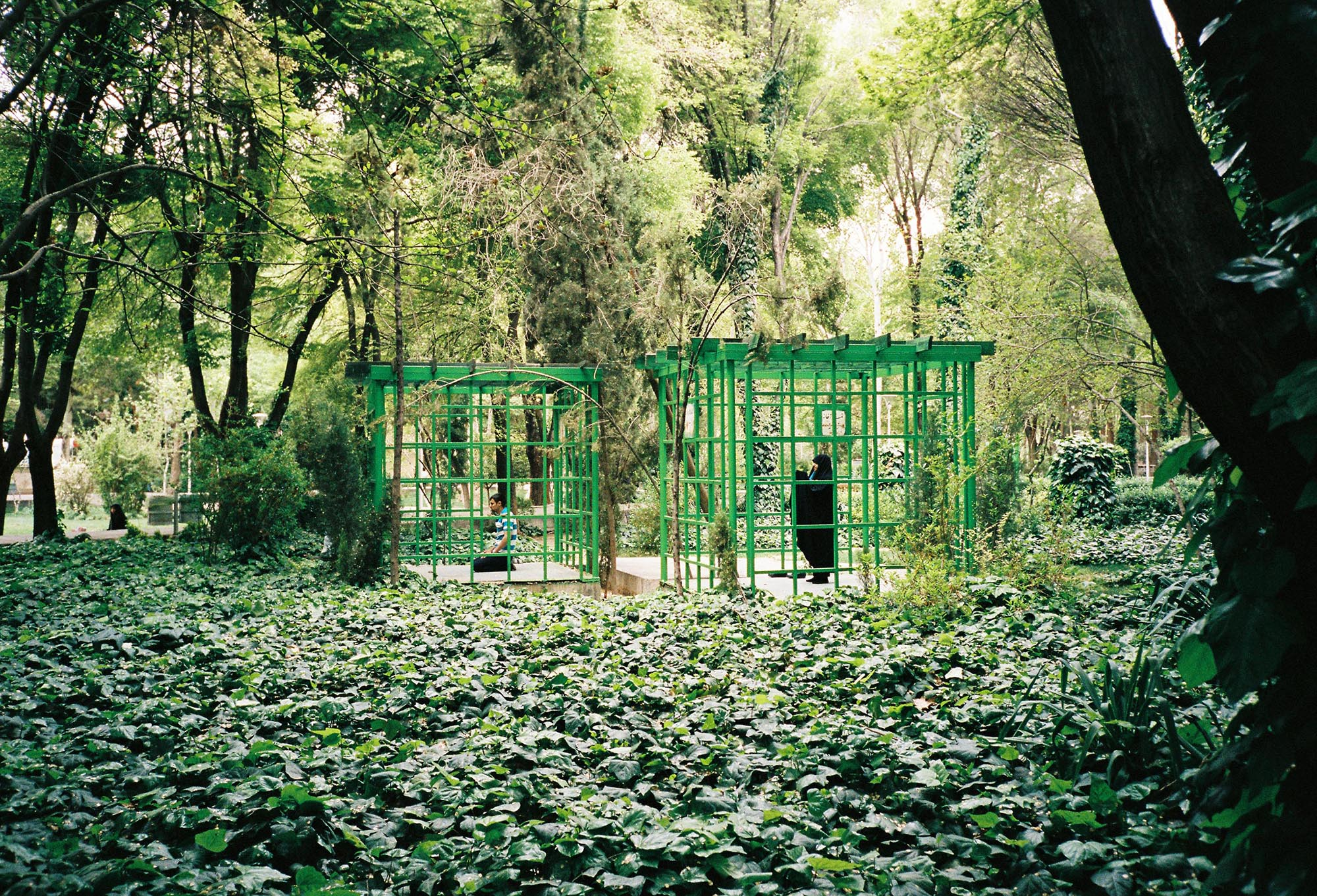 Muslims praying in cage structures in a public garden. Isfahan, Iran, 2017 © Laure d'Utruy