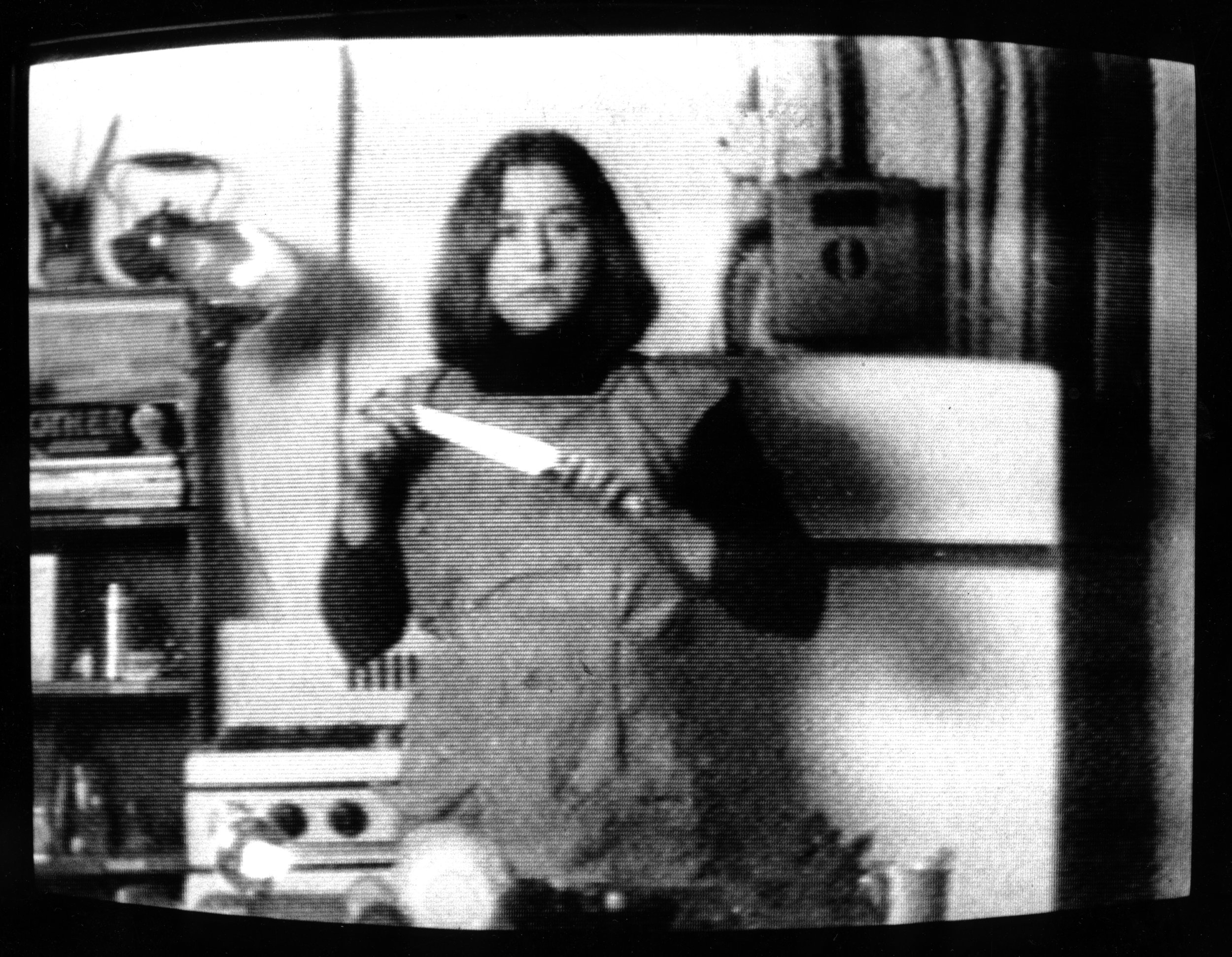 Martha Rosler, still from Semiotics of the Kitchen, 1975, black-and-white video, 6 min., 30 sec. Artwork © Martha Rosler