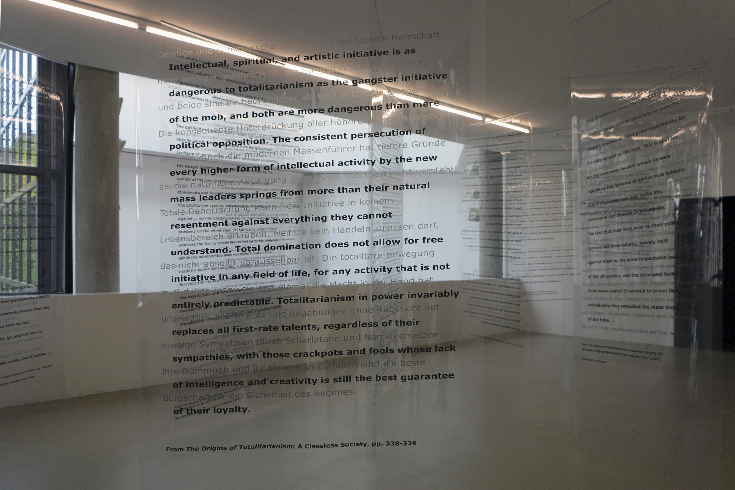Martha Rosler, detail of Reading Hannah Arendt (Politically, for an Artist in the 21st Century), 2006, installation with excerpts from Hannah Arendt's writings, in English and German, on transparent vinyl panels. Artwork © Martha Rosler