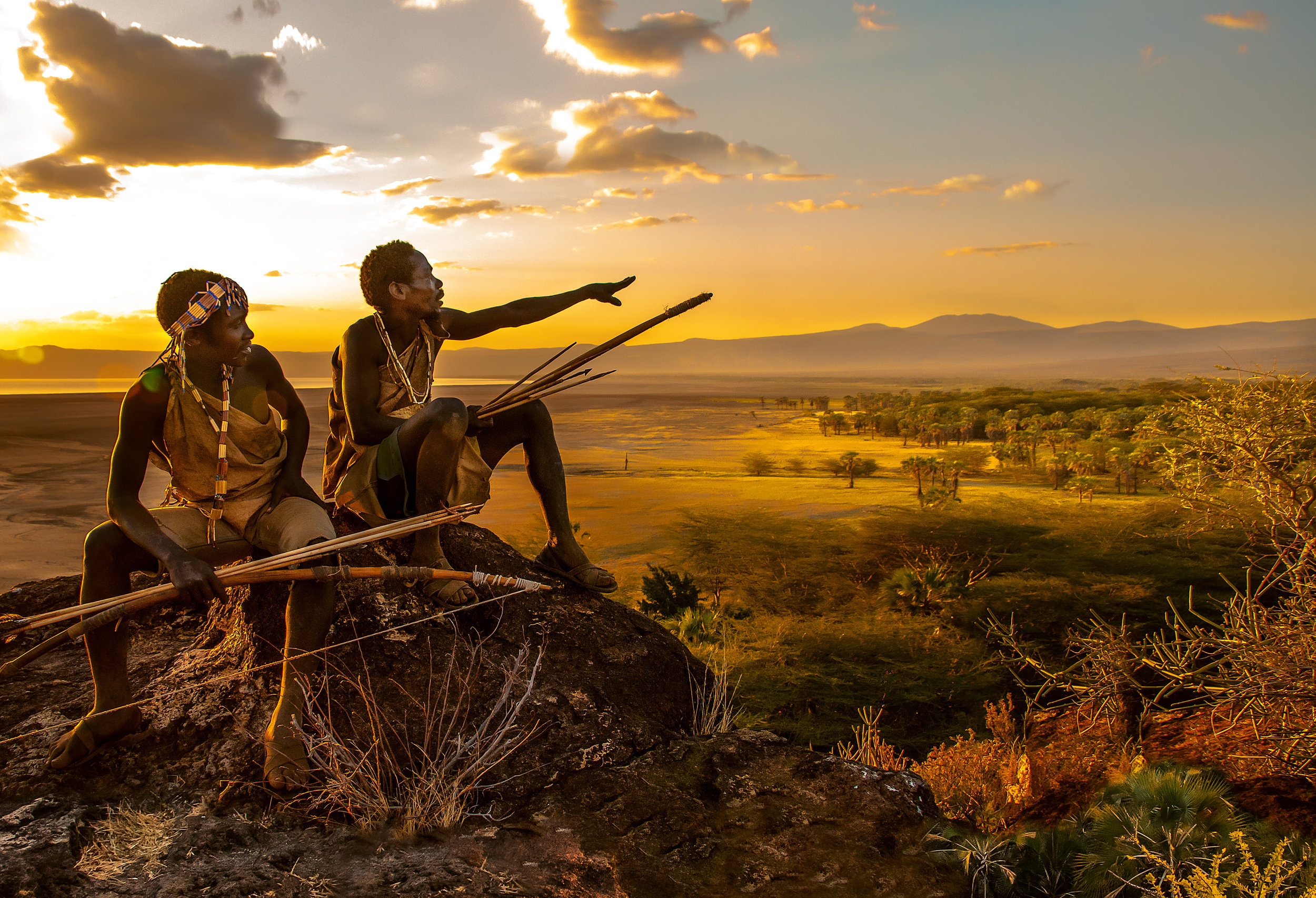Two Hadza hunters overlooking their territory bordering Lake Eyasi. © African Twilight: The Vanishing Cultures and Ceremonies of the African Continent by Carol Beckwith and Angela Fisher, Rizzoli, 2018.