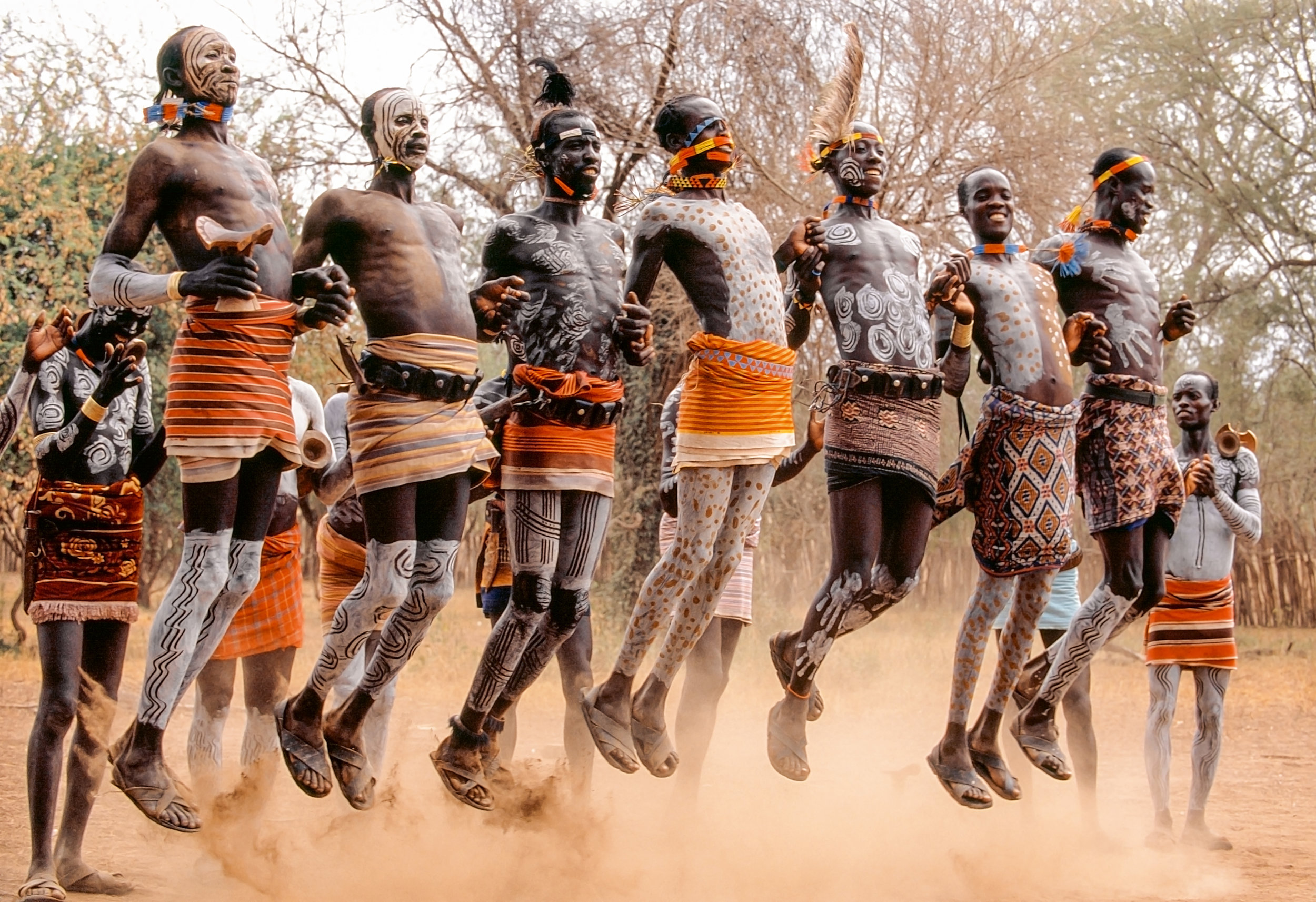 Performing the courtship dance, young Kara men form long lines and leap high in the air to impress the admiring young women. © African Twilight: The Vanishing Cultures and Ceremonies of the African Continent by Carol Beckwith and Angela Fisher, Rizzoli, 2018.