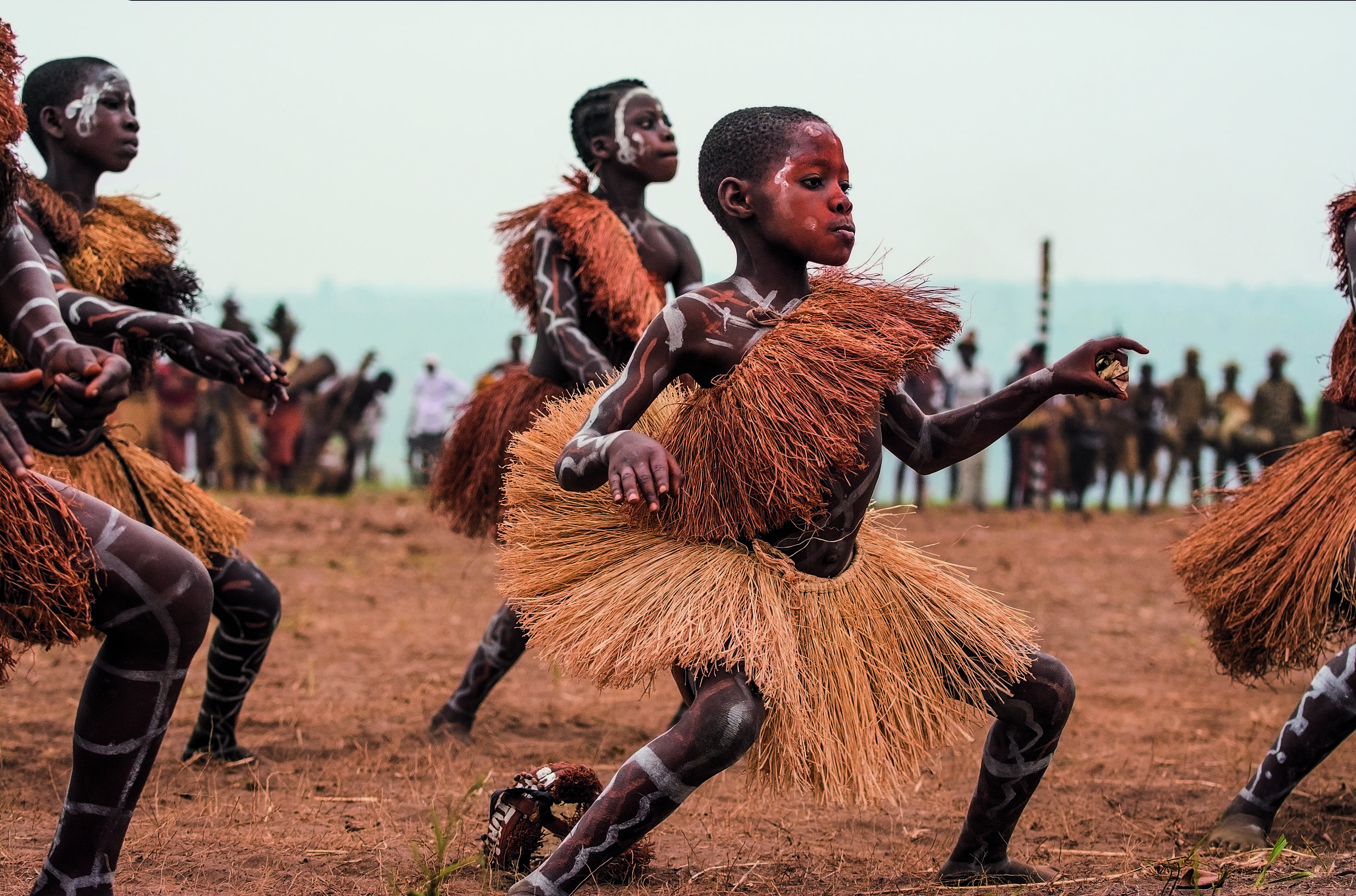 Young female initiates, decorated with chalk and ocher, perform dances that they have learned during their initiation process. © African Twilight: The Vanishing Cultures and Ceremonies of the African Continent by Carol Beckwith and Angela Fisher, Rizzoli, 2018.