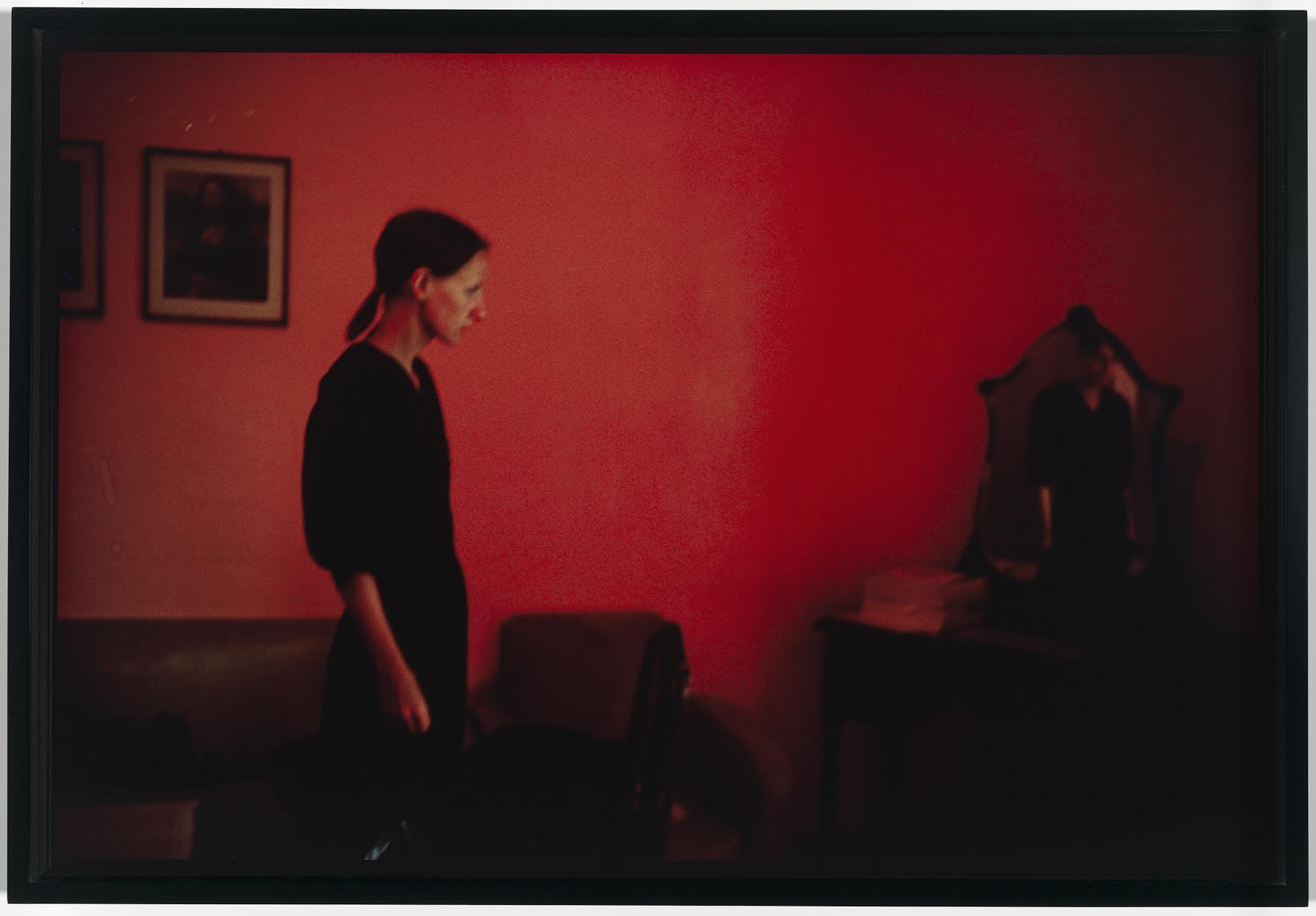 """Suzanne with Mona Lisa, Mexico City"". Nan Goldin (American, born in 1953). 1981. Photograph, silver-dye bleach print. * Gift of Davis and Carol Noble. © Nan Goldin. * Photograph © Museum of Fine Arts, Boston"