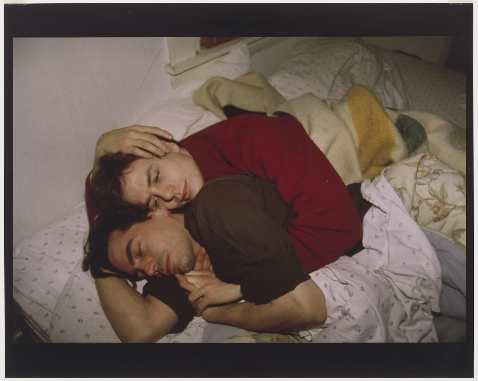 """Lewis and Matt on the Bed, Cambridge, MA"". Nan Goldin (American, born in 1953). 1988. Photograph, silver-dye bleach print. * Gift of Rudy Kikel and Sterling Giles. * Photograph © Museum of Fine Arts, Boston."