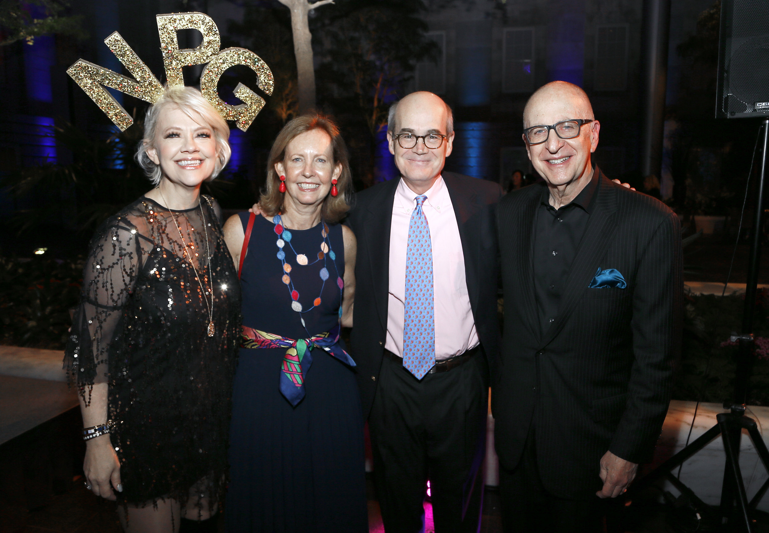 "Left to right: National Portrait Gallery Director Kim Sajet, Elizabeth Ryan, Phil Ryan, and Smithsonian Institution Secretary David J. Skorton attend the ""Face Forward Artist Party"" at the Smithsonian's National Portrait Gallery on Saturday, November 10, 2018, in Washington.  ©Photo by Paul Morigi/AP Images for National Portrait Gallery)"