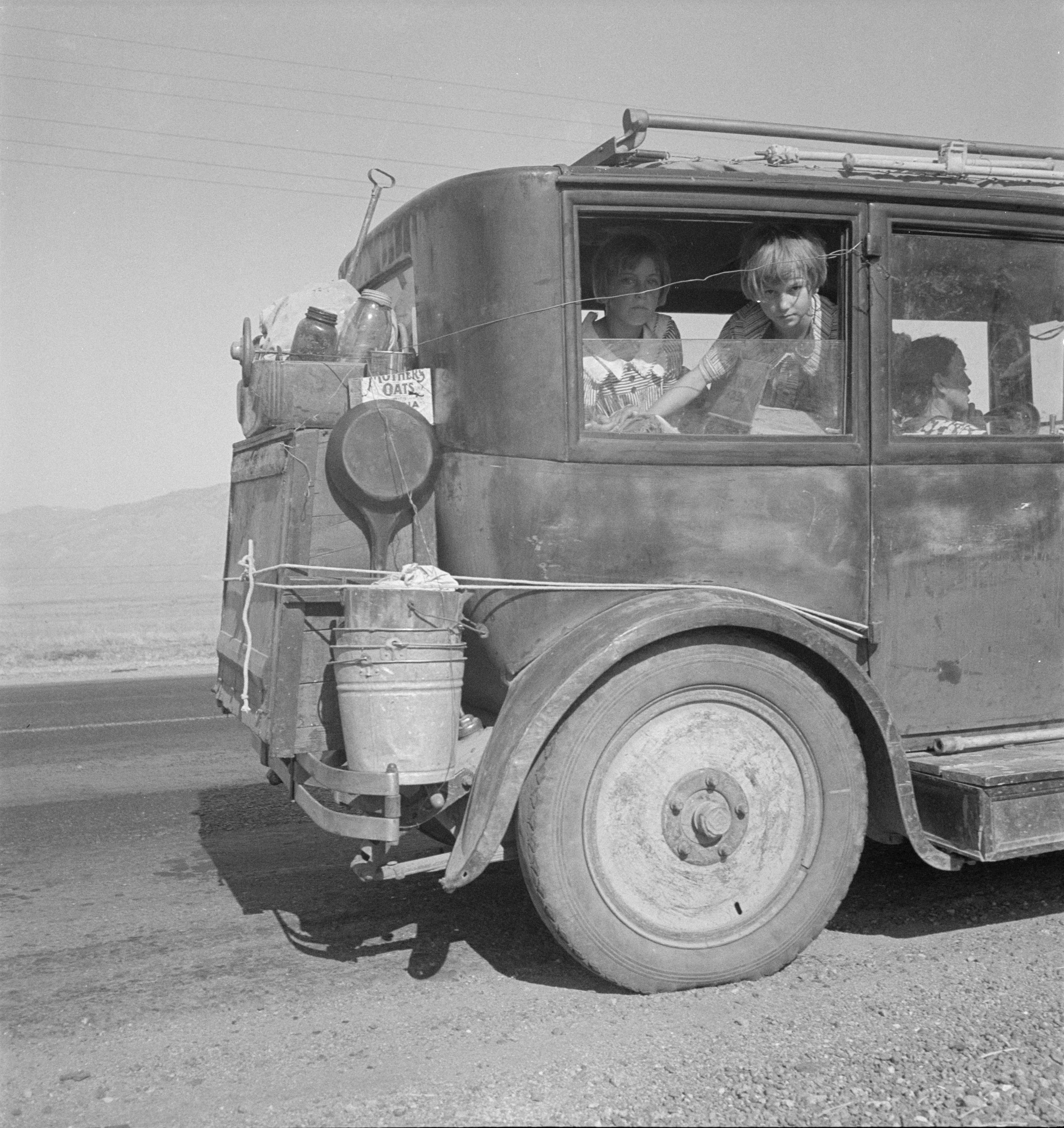 Family walking on highway - five children. Started from Idabel, Oklahoma, bound for Krebs, Oklahoma, June 1938. Library of Congress. © Dorothea Lange