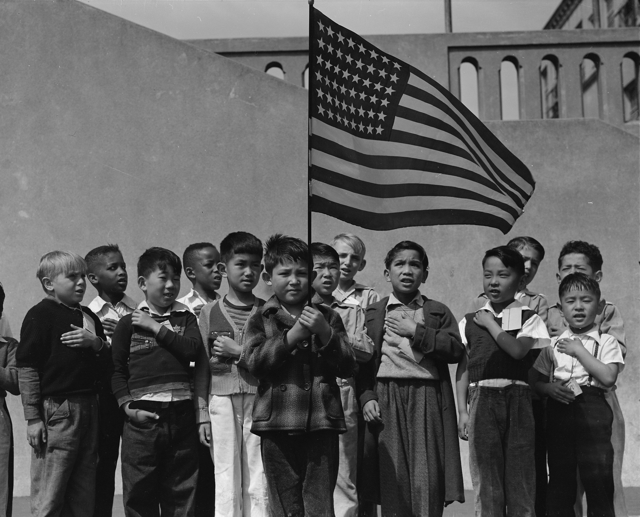 San Francisco, California. Flag of allegiance pledge at Raphael Weill Public School, Geary and Buchanan Streets. Children in families of Japanese. © Dorothea Lange