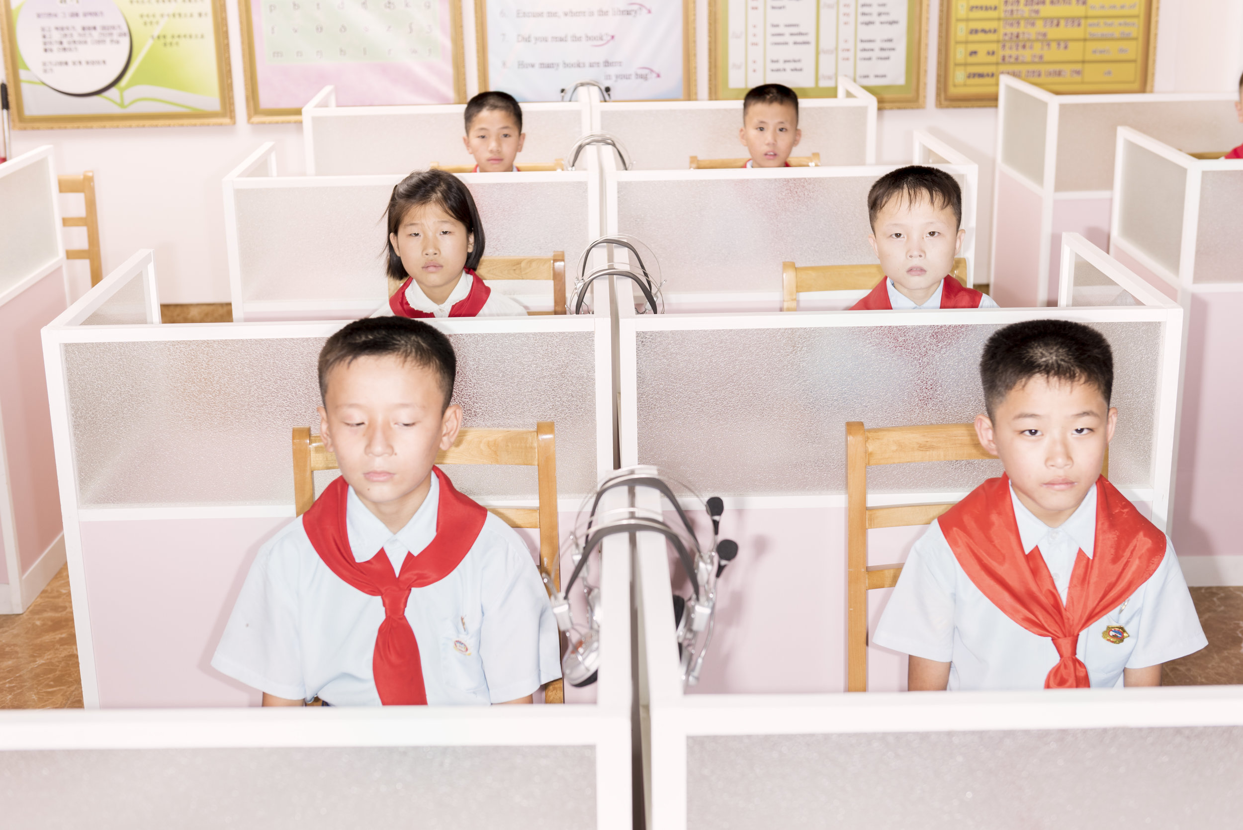 Students in the after-school english classroom at Pyongyang Orphans' Primary School. © Max Pinckers