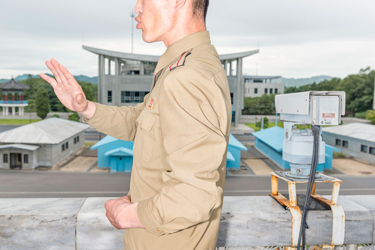 View on South Korea from the balcony at the DMZ building, shown by military guide. © Max Pinckers