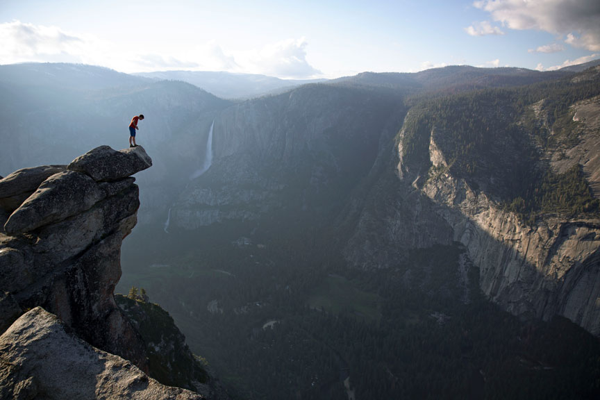 In  Free Solo , Alex Honnold peers over the edge of Glacier Point in Yosemite National Park. He had just climbed 2000 feet up from the valley floor. (National Geographic/Jimmy Chin)