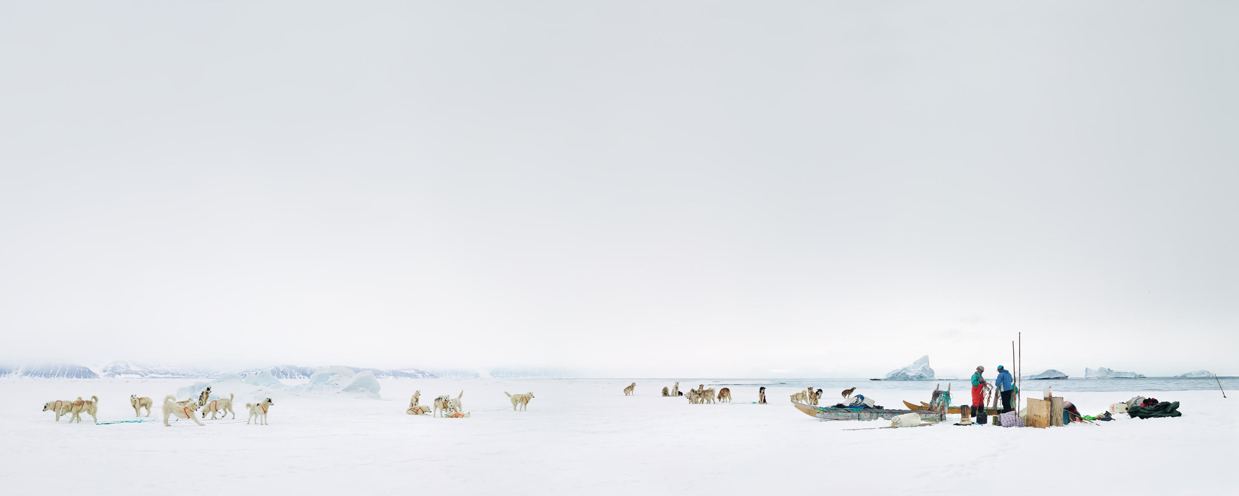 """""""Panorama After Hunt."""" © Corina Gamma, Breaking Down the Sea Ice Camp, north east of Siorapaluk, Greenland 2018, 130 inches Panorama.  Subsistence hunters Qillaq Danielsen and Peter Avike are taking down their sea ice camp after a hunting trip."""