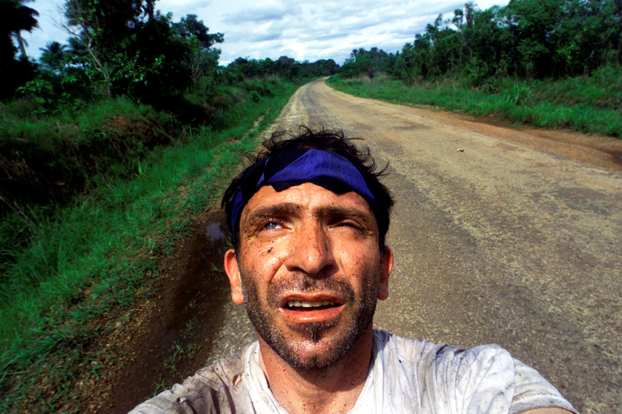 Yannis Behrakis takes a self portrait after surviving an ambush by Revolutionary United Front rebels in the jungle of Sierra Leone in which Kurt Schork and Miguel Moreno were killed, 2000. ©REUTERS/Yannis Behrakis. Courtesy of the British Journal of Photography.