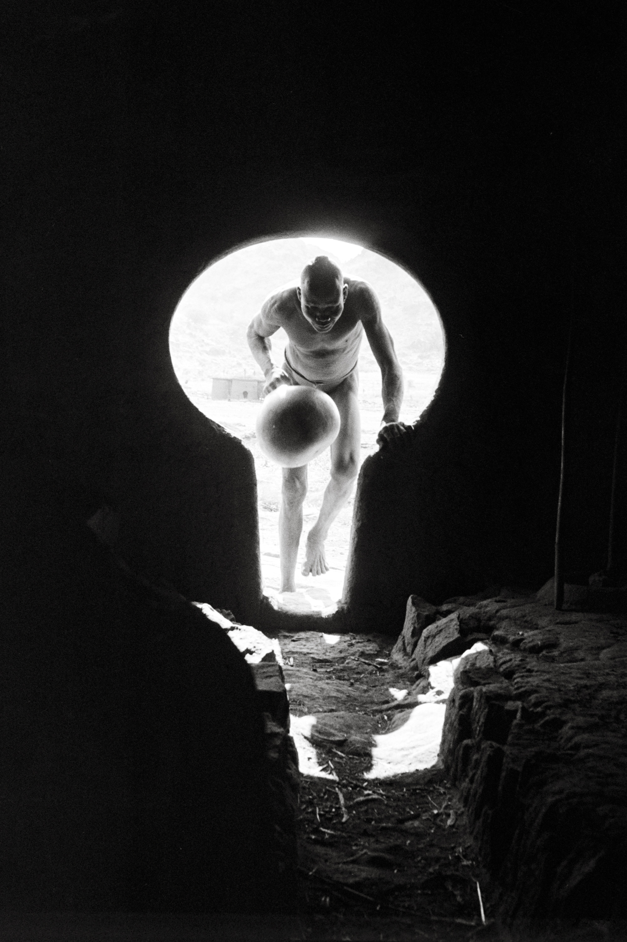Keyhole entrance to a Nuba house in the Korongo Jebels. ©George Rodger, from  Southern Sudan . Published by Stanley/Barker.